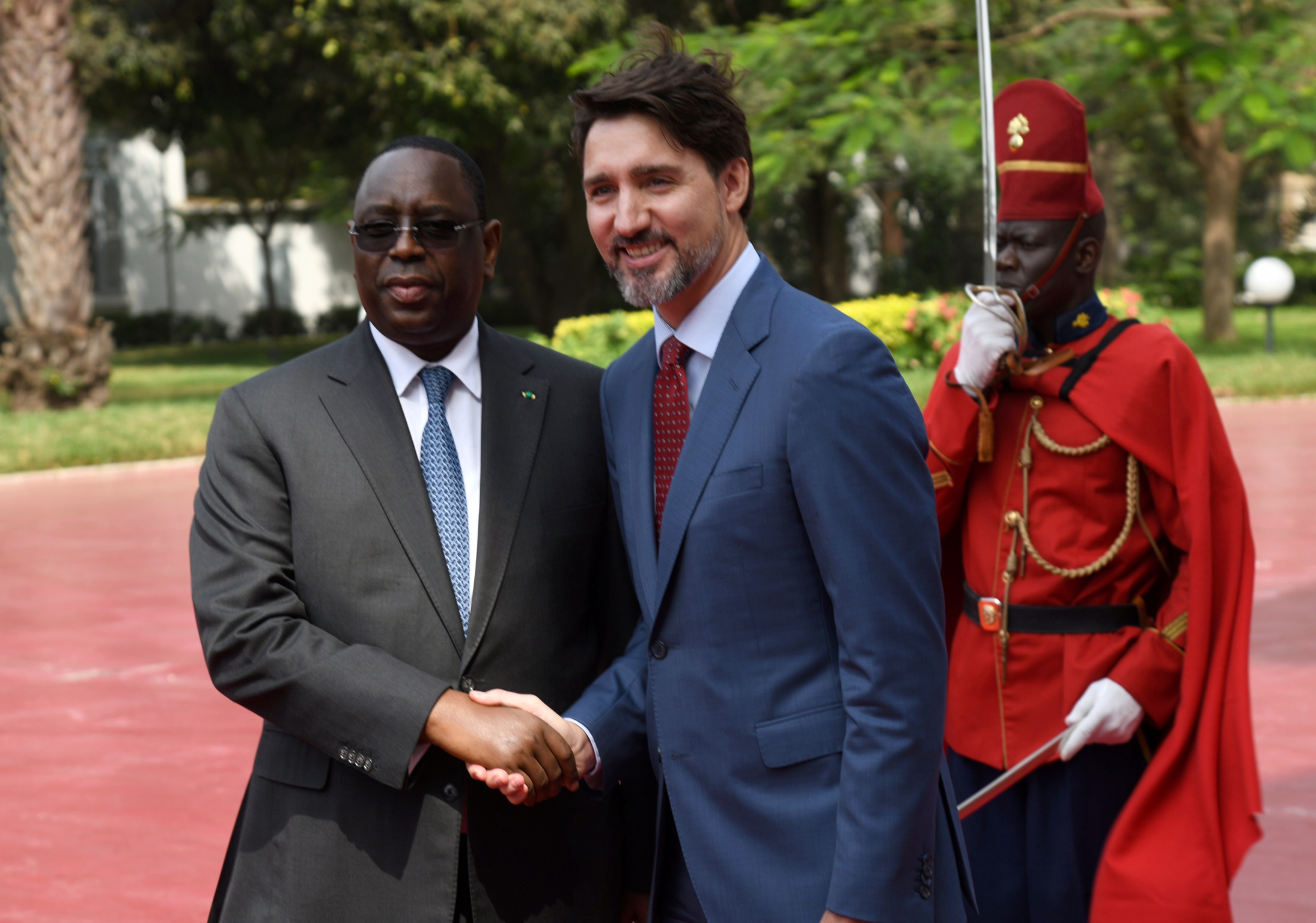 Senegal's President Macky Sall welcomes Canada's Prime Minister Justin Trudeau at the presidential palace in Dakar, Senegal February 12, 2020. REUTERS/Moustafa Cheaiteli