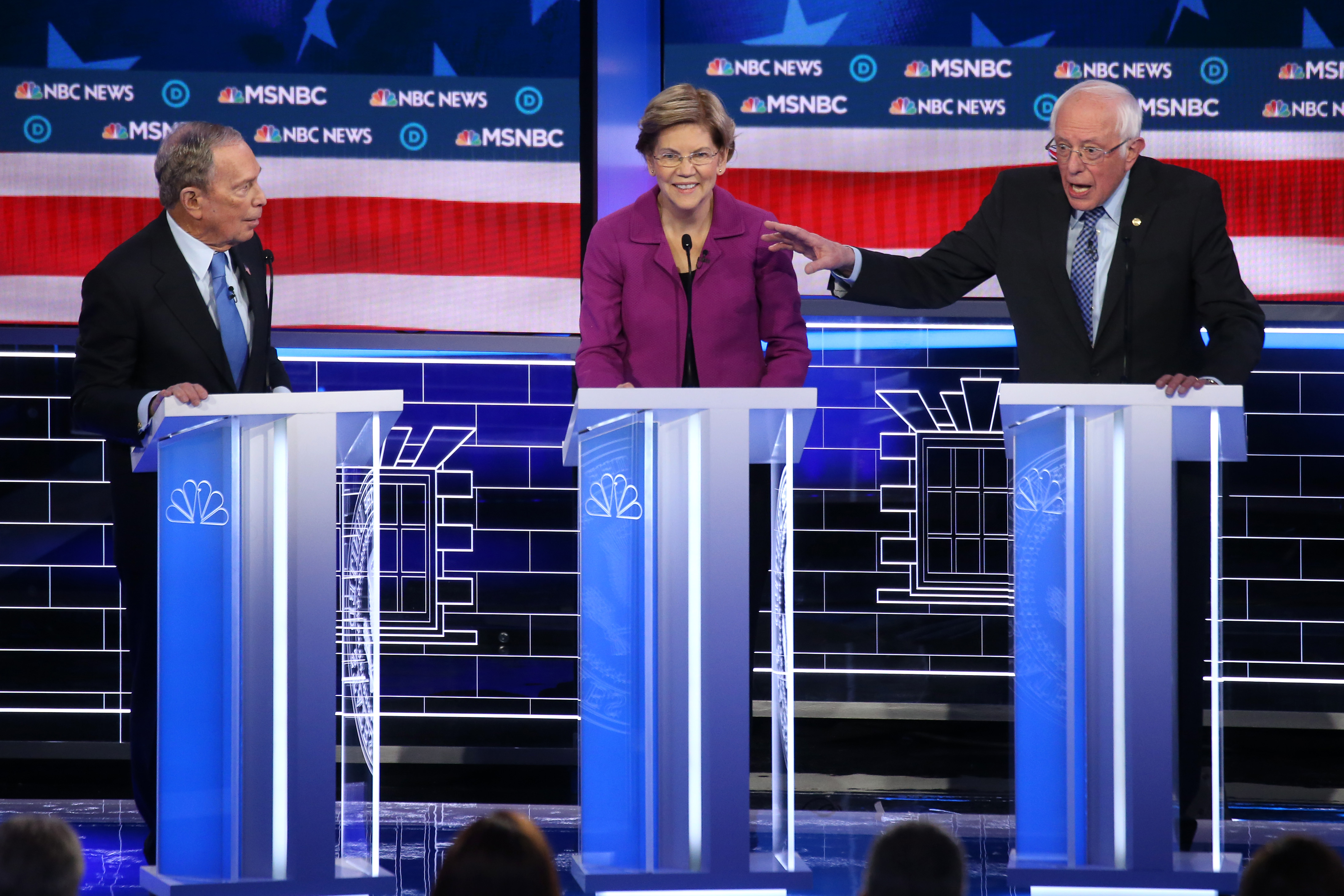 LAS VEGAS, NEVADA - FEBRUARY 19: Democratic presidential candidates former New York City mayor Mike Bloomberg (L), and Sen. Elizabeth Warren (D-MA) listen as Sen. Bernie Sanders (I-VT) makes a point during the Democratic presidential primary debate at Paris Las Vegas on February 19, 2020 in Las Vegas, Nevada. Six candidates qualified for the third Democratic presidential primary debate of 2020, which comes just days before the Nevada caucuses on February 22. (Photo by Mario Tama/Getty Images)
