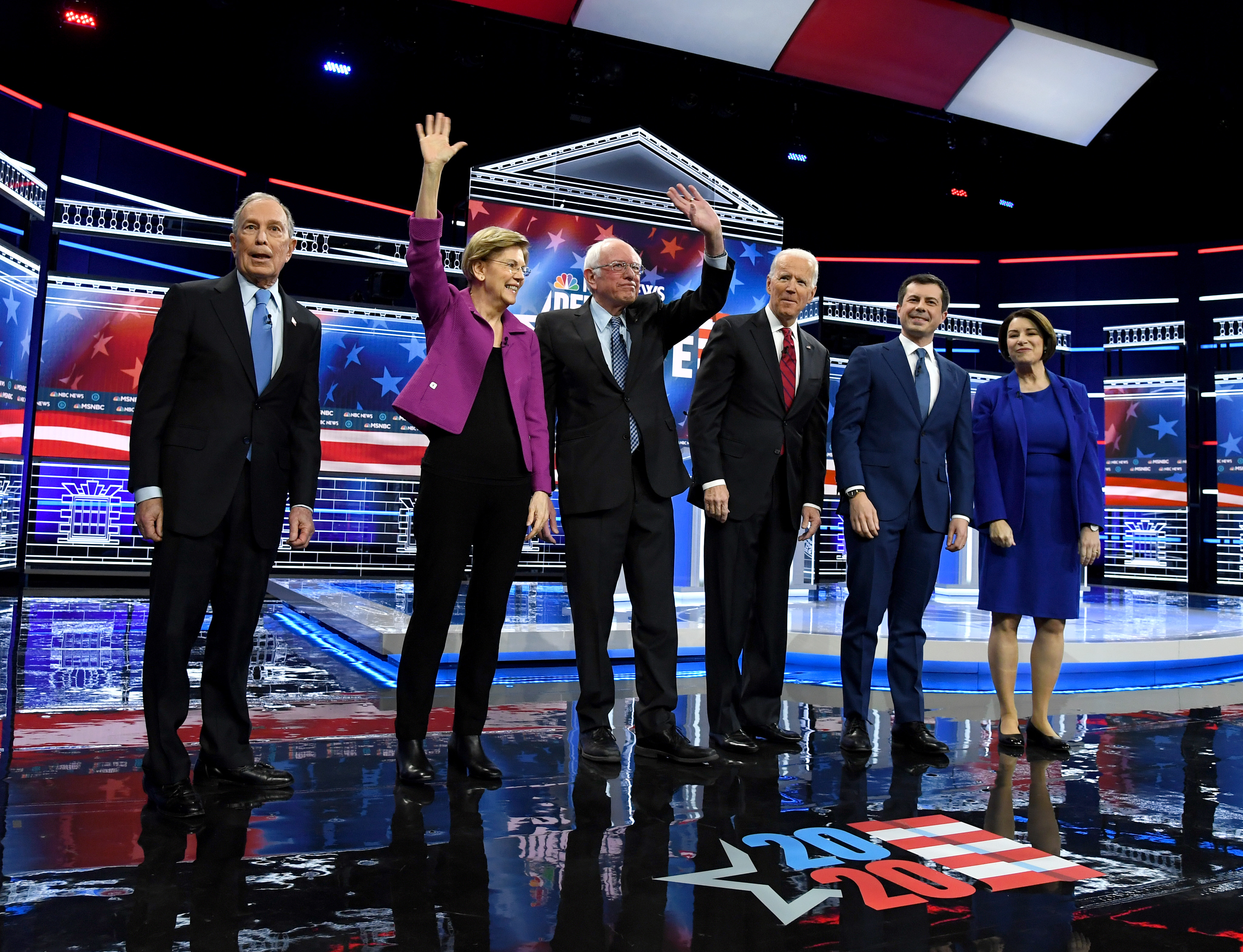 Democratic presidential candidates (L-R) former New York City Mayor Mike Bloomberg, Sen. Elizabeth Warren (D-MA), Sen. Bernie Sanders (I-VT), former Vice President Joe Biden, former South Bend, Indiana Mayor Pete Buttigieg and Sen. Amy Klobuchar (D-MN) stand onstage at the start of the Democratic presidential primary debate at Paris Las Vegas on February 19, 2020 in Las Vegas, Nevada. (Ethan Miller/Getty Images)