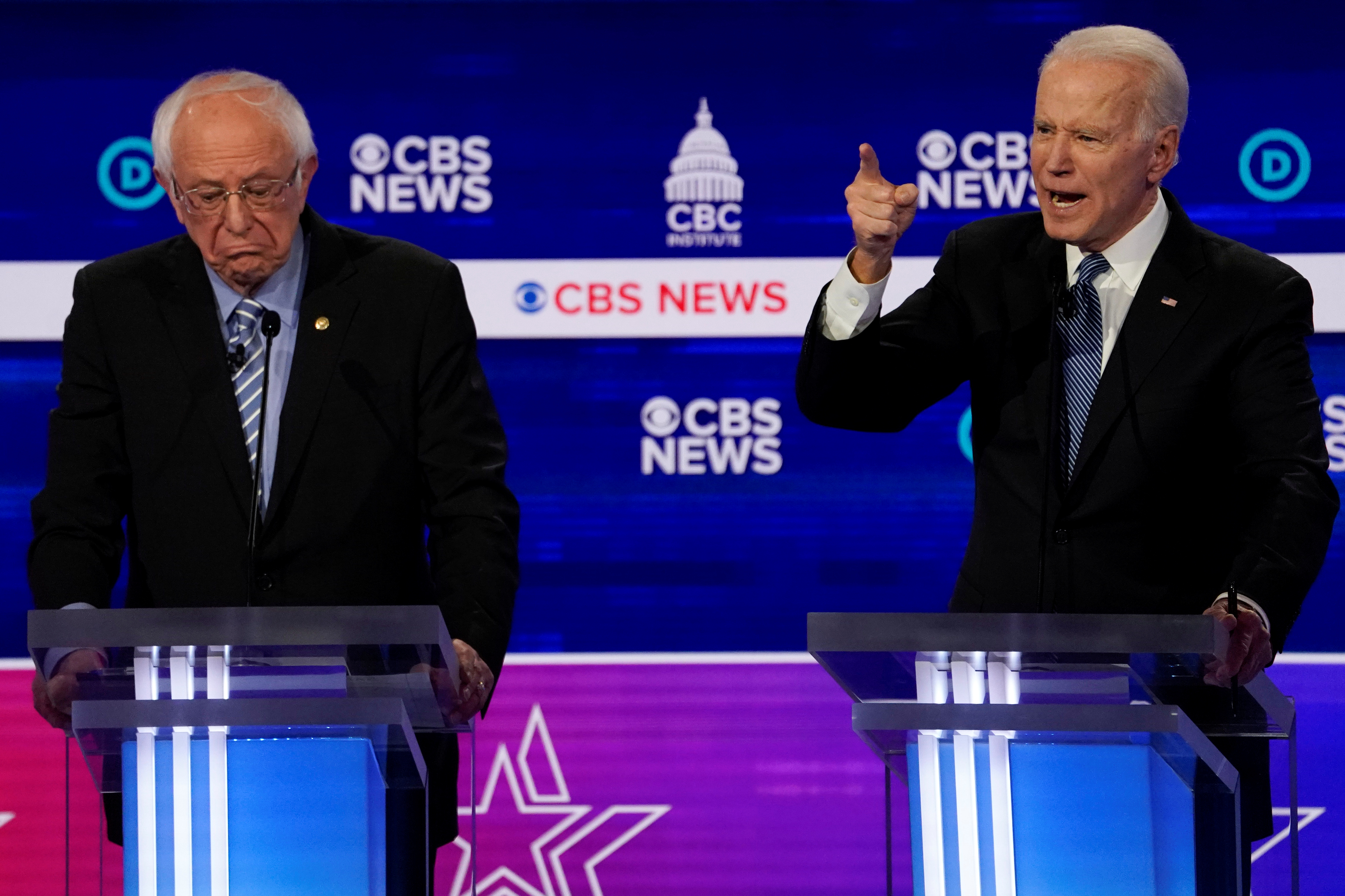 Democratic 2020 U.S. presidential candidates Senator Bernie Sanders and former Vice President Joe Biden participate in the tenth Democratic 2020 presidential debate at the Gaillard Center in Charleston, South Carolina, U.S. Feb. 25, 2020. REUTERS/Jonathan Ernst