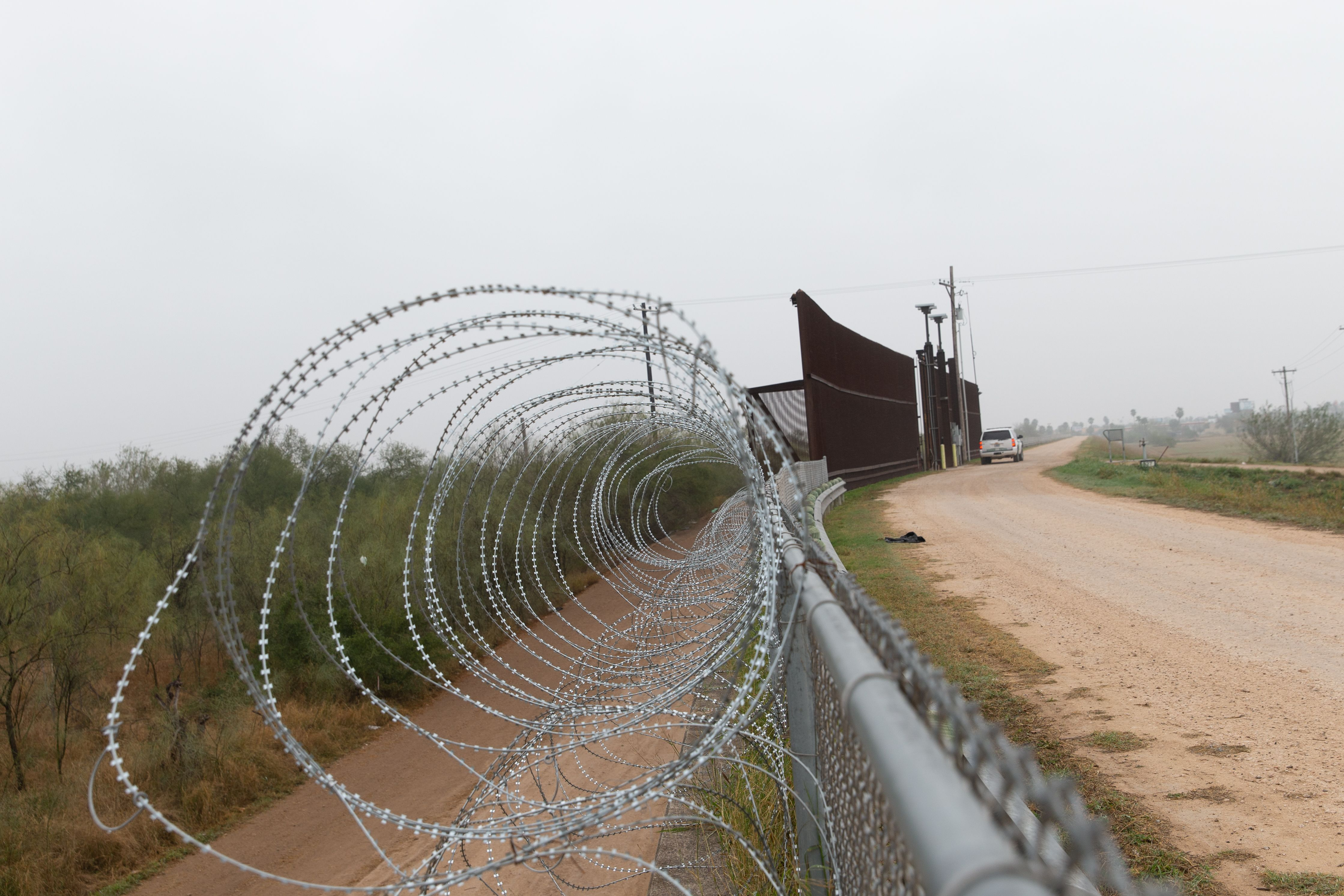 This photo shows a fence with barbed wire on the US side of the US-Mexican border on January 15, 2019 in McAllen, Texas. (SUZANNE CORDEIRO/AFP via Getty Images)