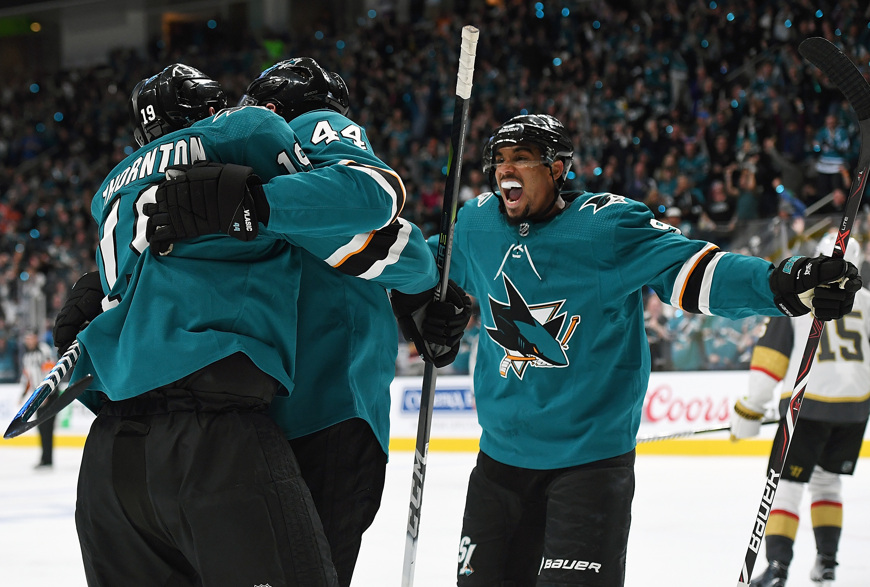 SAN JOSE, CA - APRIL 10: Marc-Edouard Vlasic #44, Joe Thornton #19 of and Evander Kane #9 the San Jose Sharks celebrates after Vlasic scored a goal against the Vegas Golden Knights during the second period in Game One of the Western Conference First Round during the 2019 NHL Stanley Cup Playoffs at SAP Center on April 10, 2019 in San Jose, California. (Photo by Thearon W. Henderson/Getty Images)