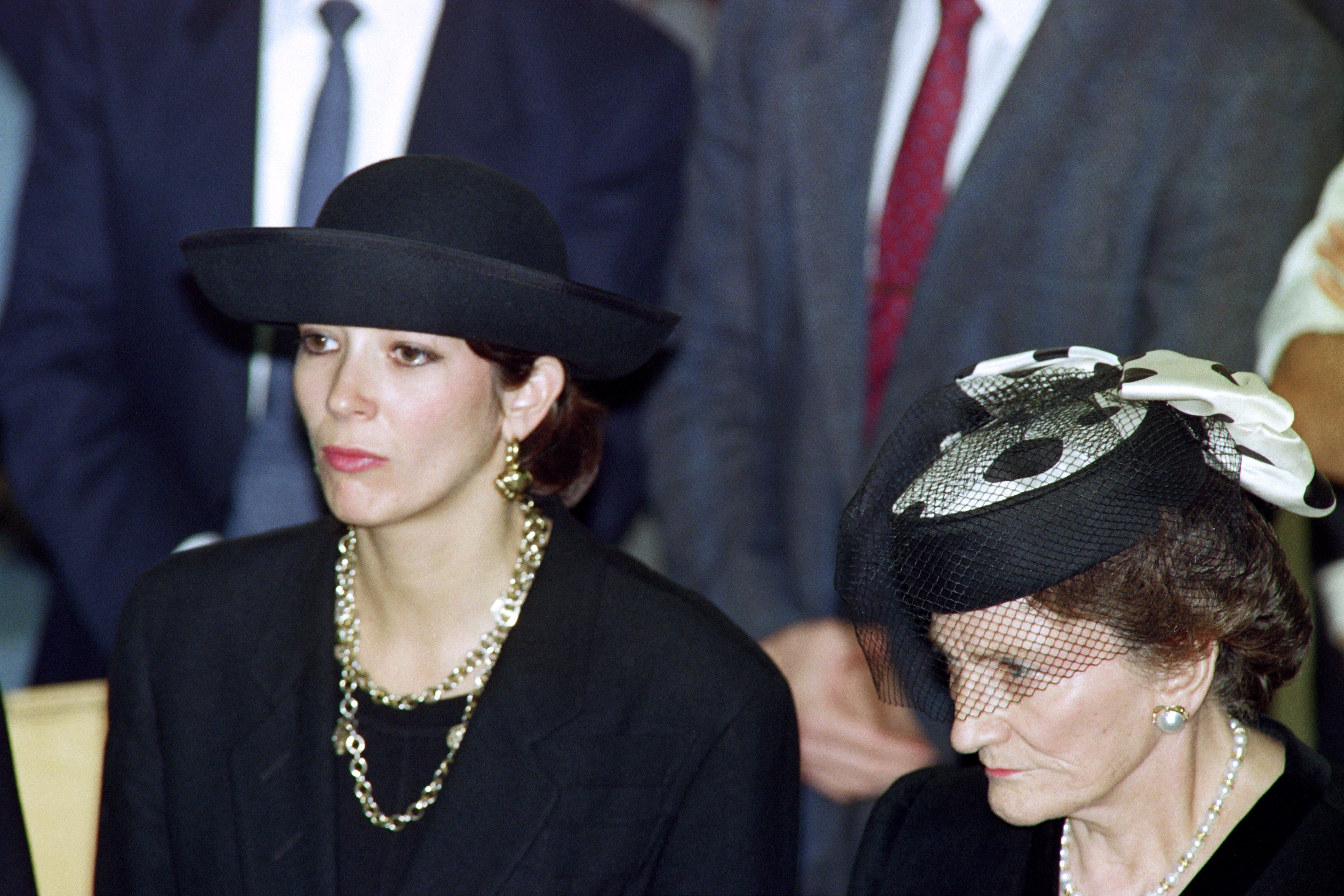 British press magnat Robert Maxwell's daughter Ghislaine (L) and wife Elisabeth (R) attend the funeral serice for burial on the Mount of Olives of their father and husband on November 10, 1991. (SVEN NACKSTRAND/AFP via Getty Images)