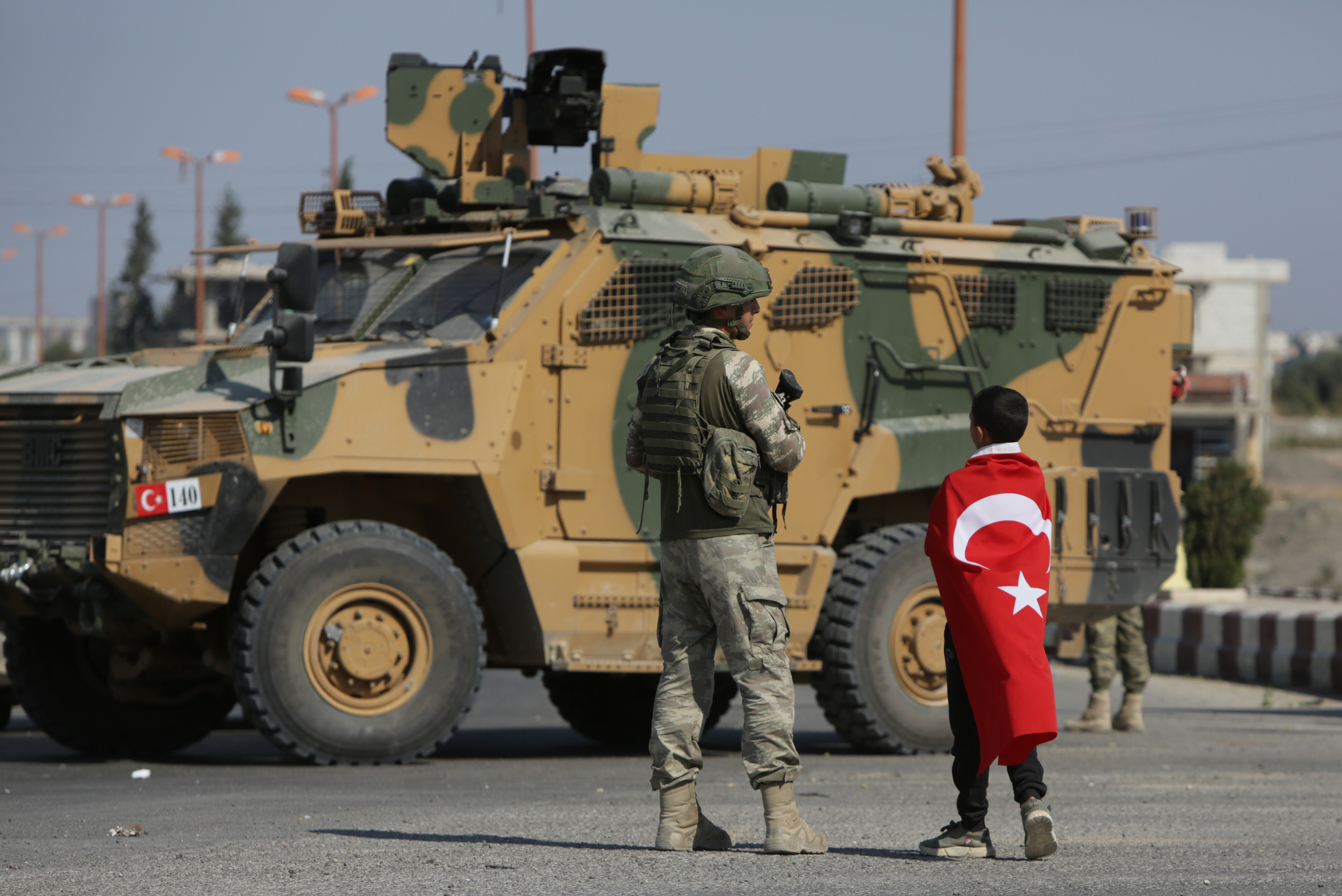 Turkish soldiers patrol the northern Syrian Kurdish town of Tal Abyad, on the border between Syria and Turkey, on October 23, 2019. - Moscow's forces in Syria headed for the border with Turkey today to ensure Kurdish fighters are pulling back after a Turkish-Russian deal wrested control of the Kurds' entire heartland. Kurdish forces, who controlled close to a third of Syria two weeks ago, have now lost almost everything, after the agreement signed in Sochi granted Turkey the right to remain fully deployed in an Arab-majority area that was the main target of an offensive launched on October 9. (Photo by BAKR ALKASEM/AFP via Getty Images)