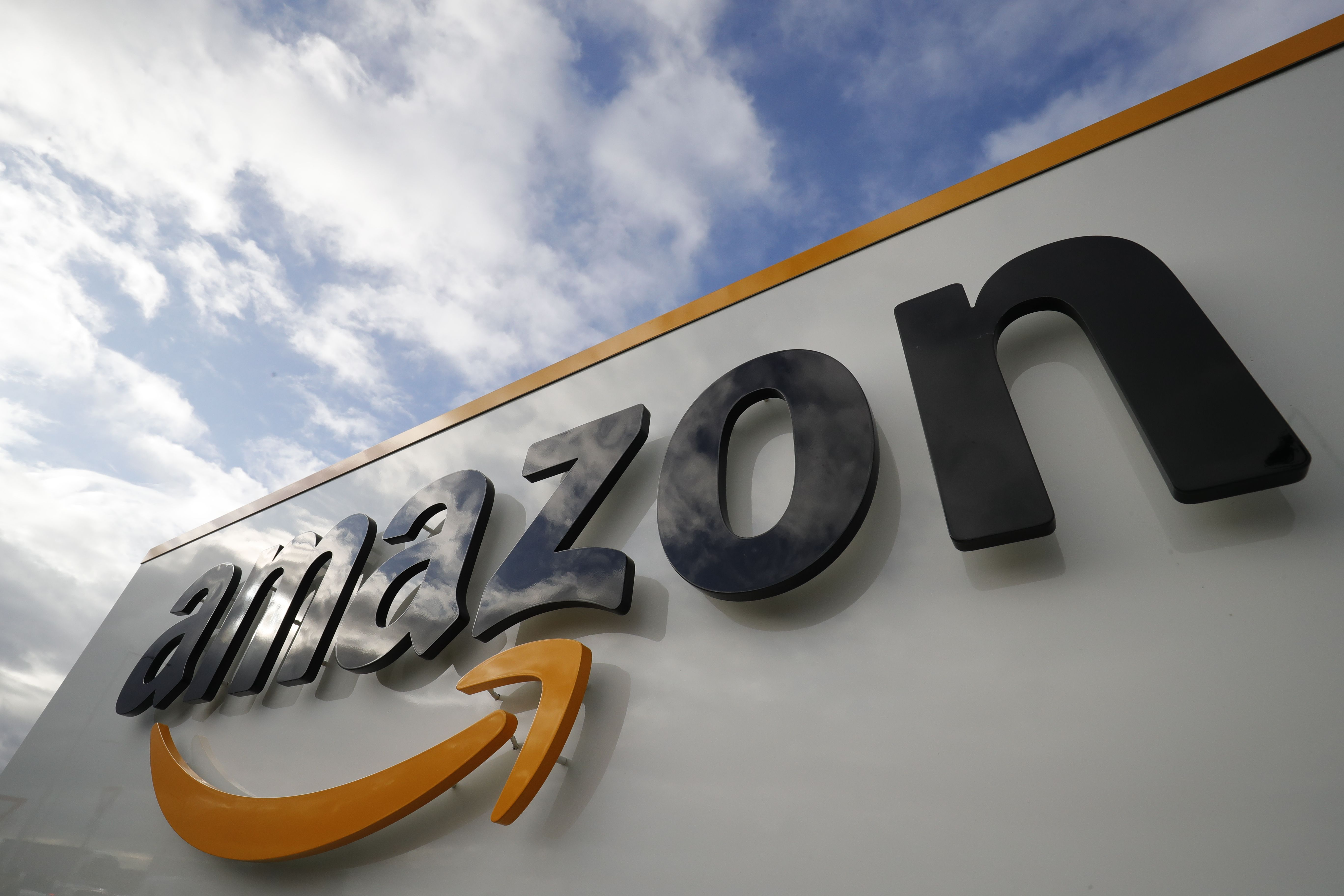 This picture shows the Amazon logo at one of the company's centre in Bretigny-sur-Orge on November 28, 2019 (Photo by THOMAS SAMSON/AFP via Getty Images)