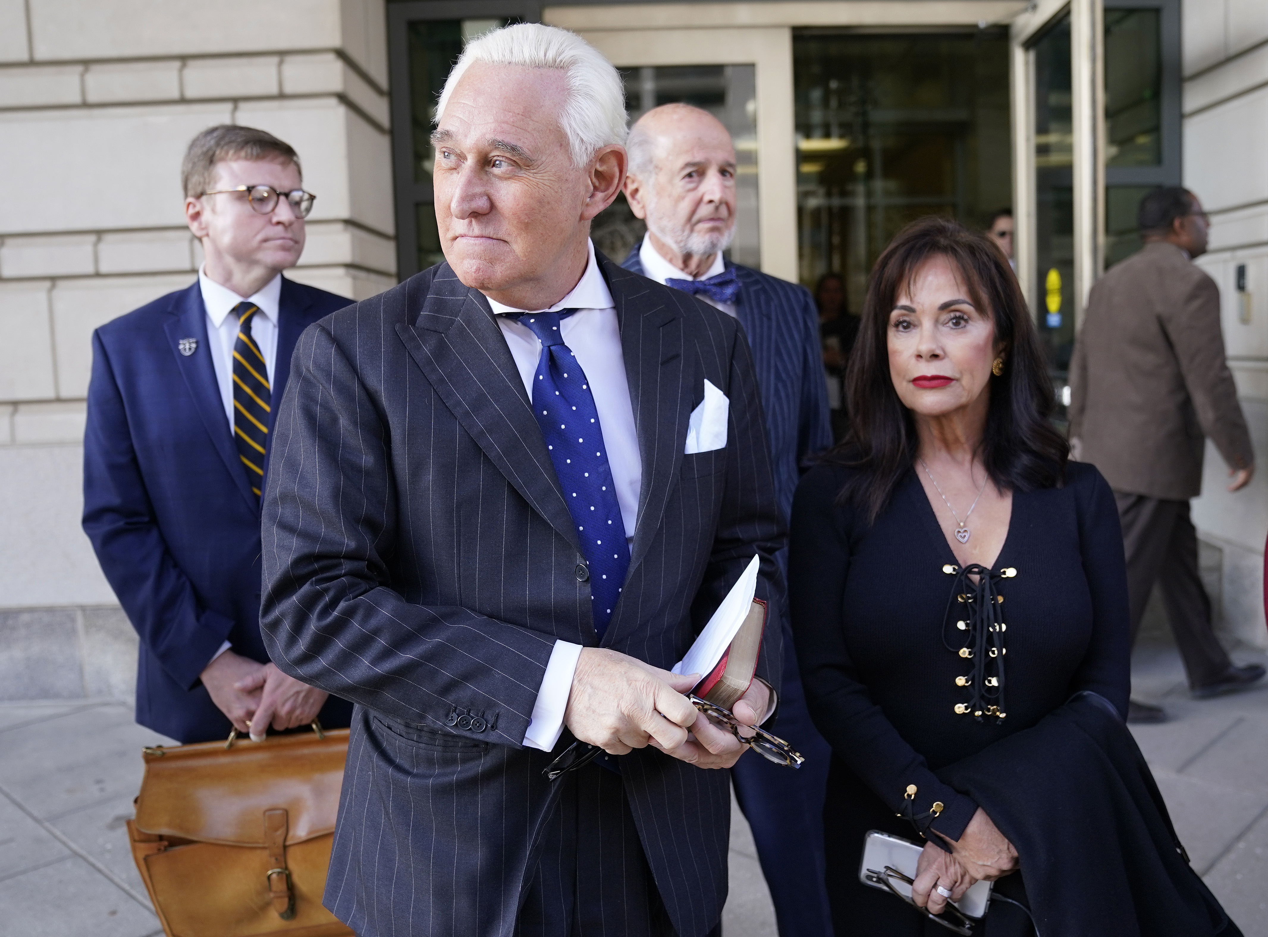Former advisor to U.S. President Donald Trump, Roger Stone (2nd L), departs the E. Barrett Prettyman United States Courthouse with his wife Nydia (R) after being found guilty of obstructing a congressional investigation into Russia's interference in the 2016 election. (Win McNamee/Getty Images)