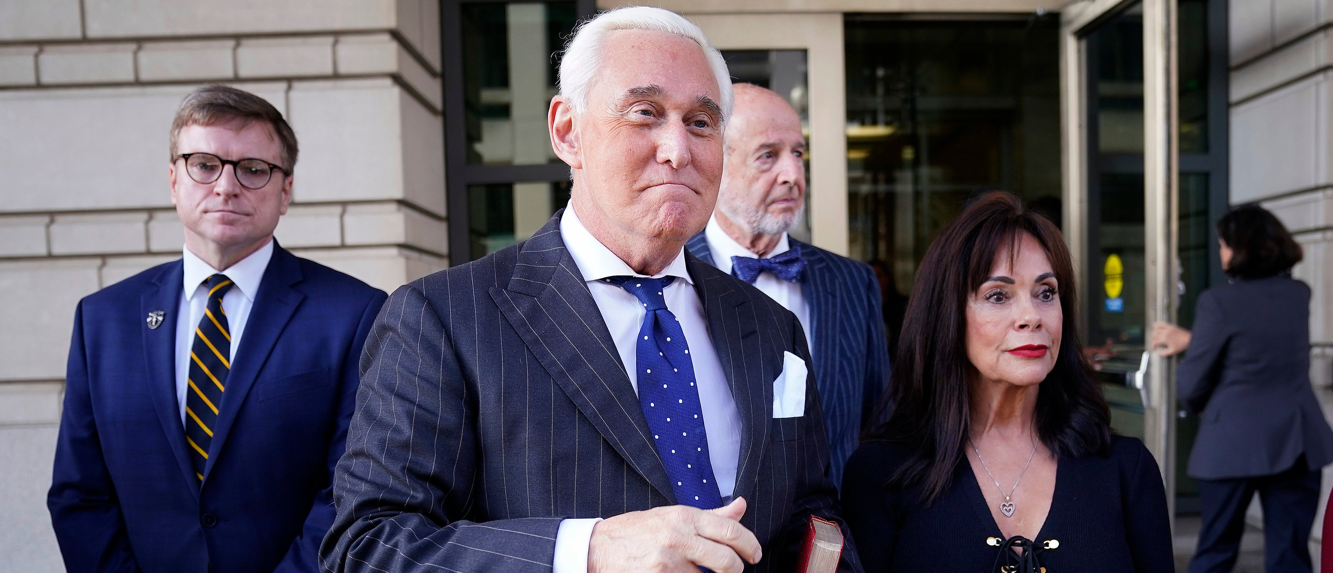 Former advisor to U.S. President Donald Trump, Roger Stone (2nd L), departs the E. Barrett Prettyman United States Courthouse with his wife Nydia (R) after being found guilty of obstructing a congressional investigation into Russia's interference in the 2016 election on November 15, 2019 in Washington, DC. (Win McNamee/Getty Images)