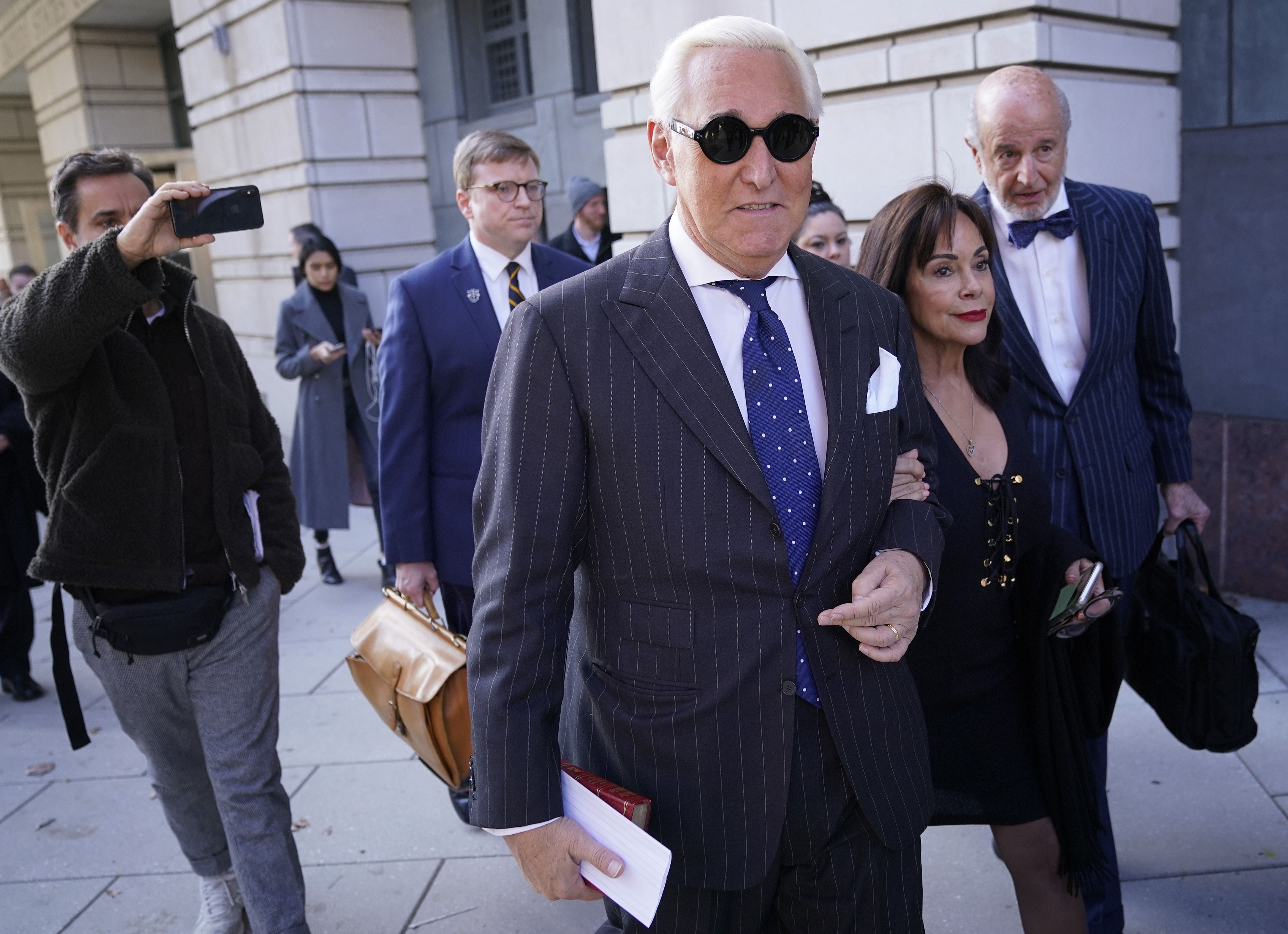 WASHINGTON, DC - NOVEMBER 15: Former advisor to U.S. President Donald Trump, Roger Stone, departs the E. Barrett Prettyman United States Courthouse with his wife Nydia after being found guilty of obstructing a congressional investigation into Russia's interference in the 2016 election on November 15, 2019 in Washington, DC. Stone faced seven felony charges and was found guilty on all counts. (Photo by Win McNamee/Getty Images)
