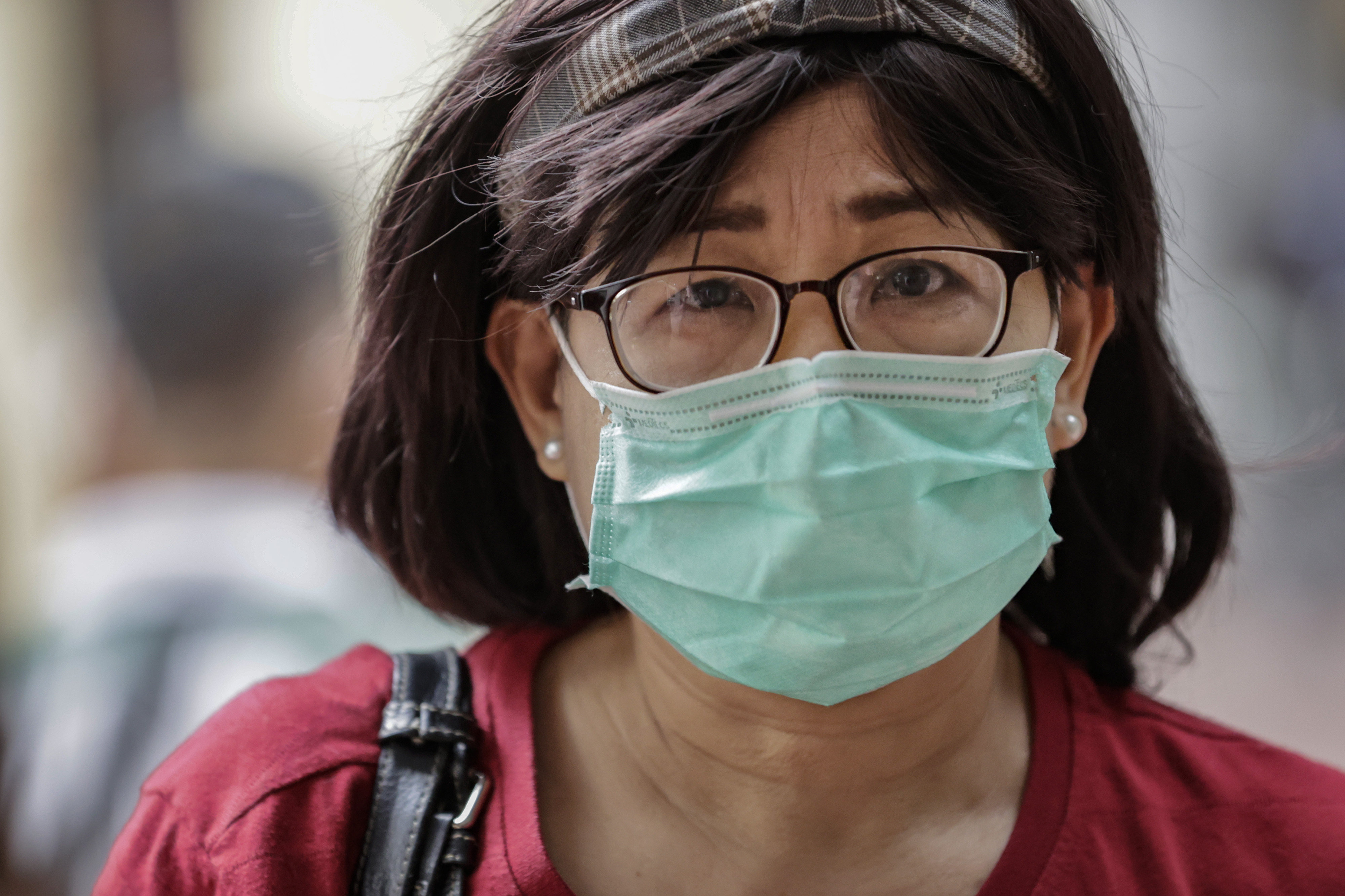 FEBRUARY 03: A woman is seen wearing a face mask, as public fear over China's Wuhan Coronavirus grows, on February 3, 2020 in Manila, Philippines. The Philippine government has been heavily criticized after failing to immediately implement travel restrictions on China, the source of a deadly coronavirus that has now killed more than 300 people and infected thousands more. On Sunday, the first coronavirus death outside of China was reported in the Philippines. (Photo by Ezra Acayan/Getty Images)