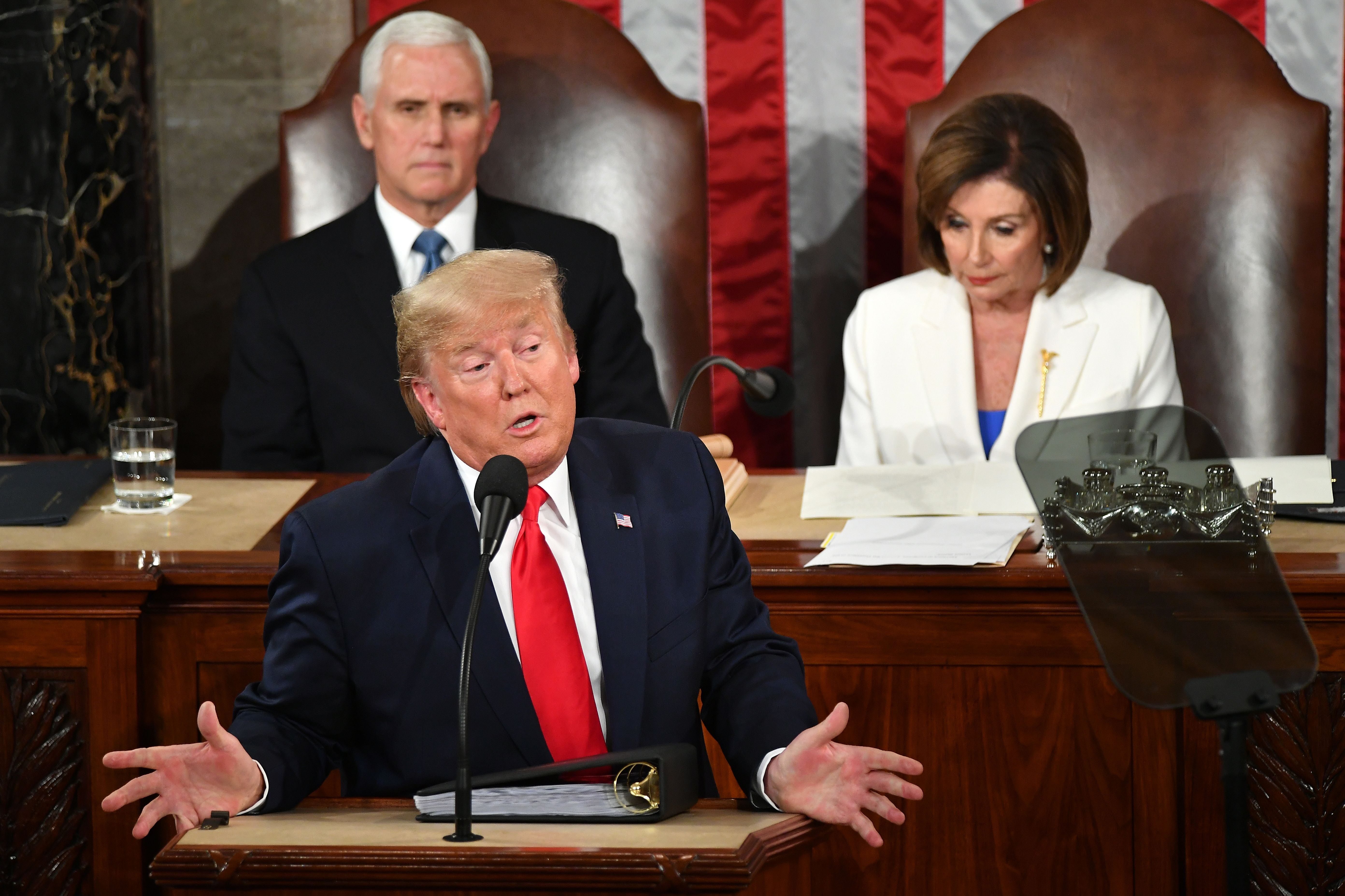 US President Donald Trump delivers the State of the Union address flanked by US Vice President Mike Pence (L) and Speaker of the US House of Representatives Nancy Pelosi (R) at the US Capitol in Washington, DC, on February 4, 2020. (Photo by MANDEL NGAN/AFP via Getty Images)