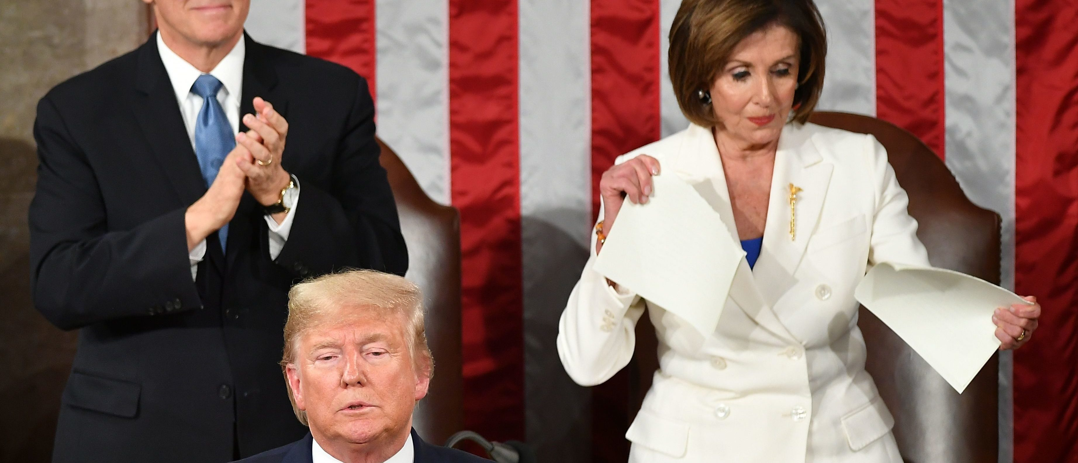 US Vice President Mike Pence claps as Speaker of the US House of Representatives Nancy Pelosi appears to rip a copy of US President Donald Trumps speech after he delivers the State of the Union address at the US Capitol in Washington, DC, on February 4, 2020. (Photo by MANDEL NGAN/AFP via Getty Images)