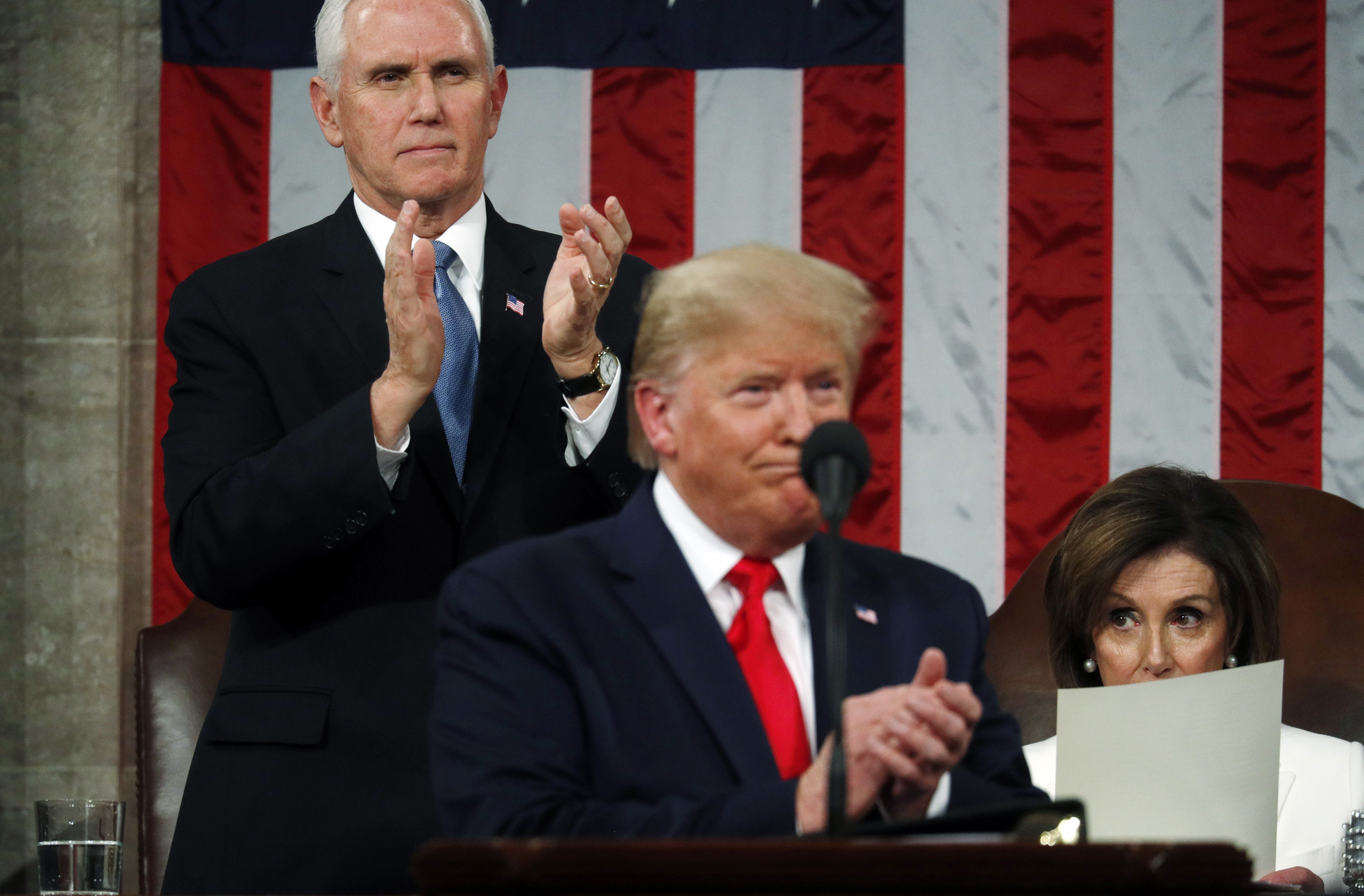 WASHINGTON, DC - FEBRUARY 04: U.S. Vice President Mike Pence applauds as House Speaker Nancy Pelosi remains seated during U.S. President Donald Trump's State of the Union address in the House chamber on February 4, 2020 in Washington, DC. Trump is delivering his third State of the Union address on the night before the U.S. Senate is set to vote in his impeachment trial. (Photo by Leah Millis-Pool/Getty Images)