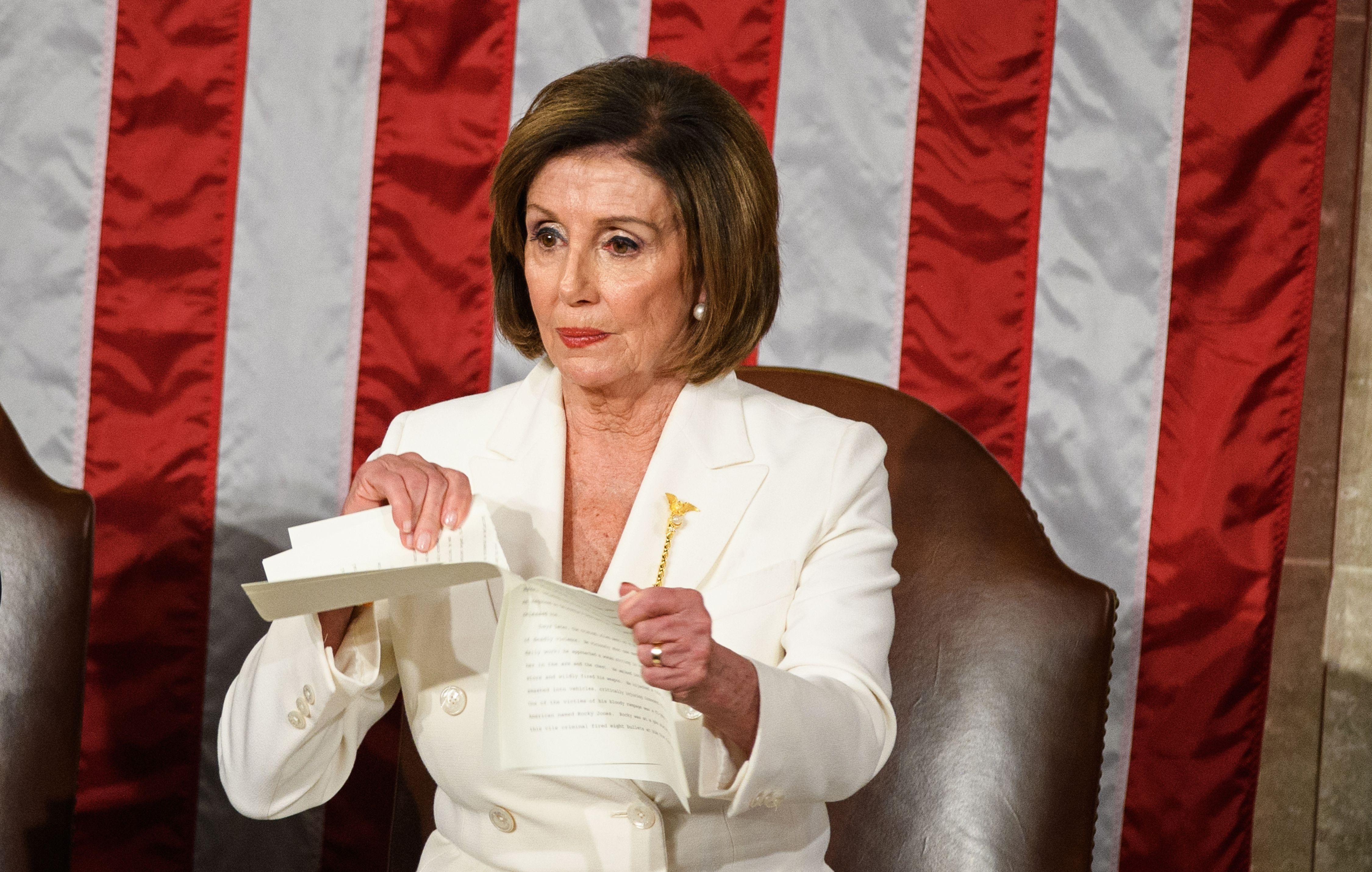 Speaker of the US House of Representatives Nancy Pelosi rips a copy of US President Donald Trumps speech after he delivers the State of the Union address at the US Capitol in Washington, DC, on February 4, 2020. (Photo by MANDEL NGAN / AFP) (Photo by MANDEL NGAN/AFP via Getty Images)