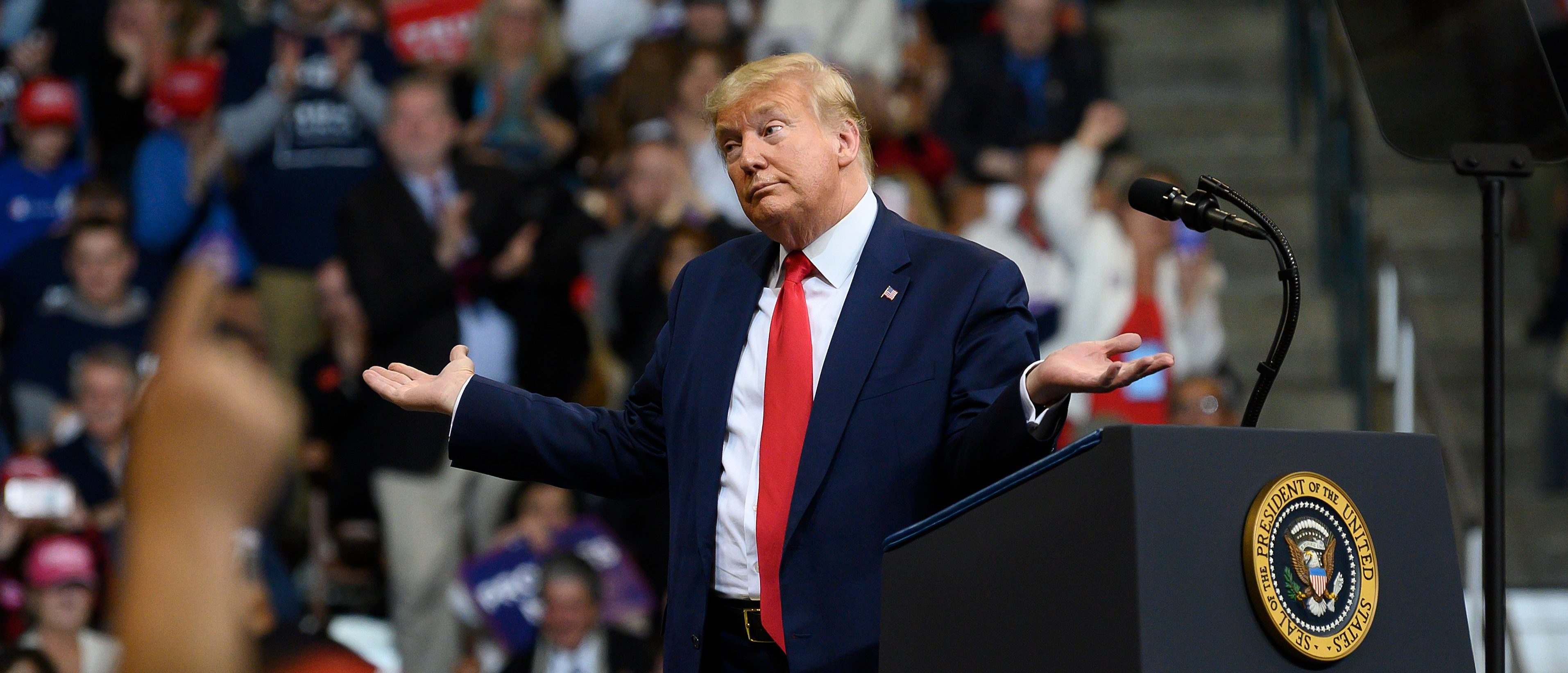"""US President Donald Trump looks at his supporters after reading words from Al Wilson's song """"The Snake"""" during a rally in Manchester, New Hampshire on February 10, 2020. (Photo by JIM WATSON / AFP) (Photo by JIM WATSON/AFP via Getty Images)"""