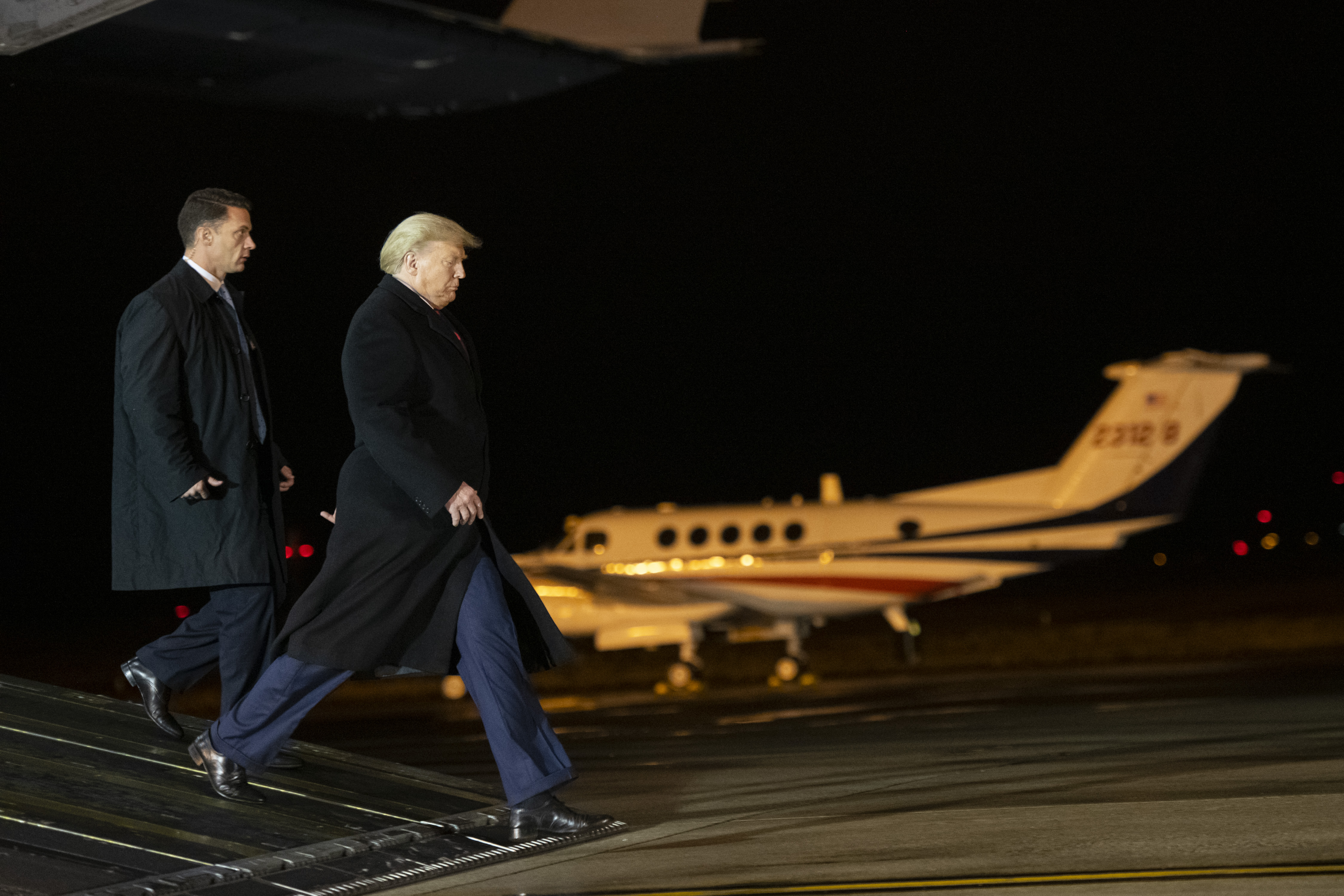 DOVER, DE - FEBRUARY 10: U.S. President Donald J. Trump descends a ramp from a C-17 aircraft while attending a dignified transfer for fallen service members U.S. Army Sgt. 1st Class Javier J. Gutierrez, 28, and Army Sgt. 1st Class Antonio R. Rodriguez, 28, at Dover Air Force Base on February 10, 2020 in Dover, Delaware. Both soldiers were killed in an attack in the Nangarhar province of Afghanistan on Saturday, according to a Department of Defense release. (Photo by Mark Makela/Getty Images)