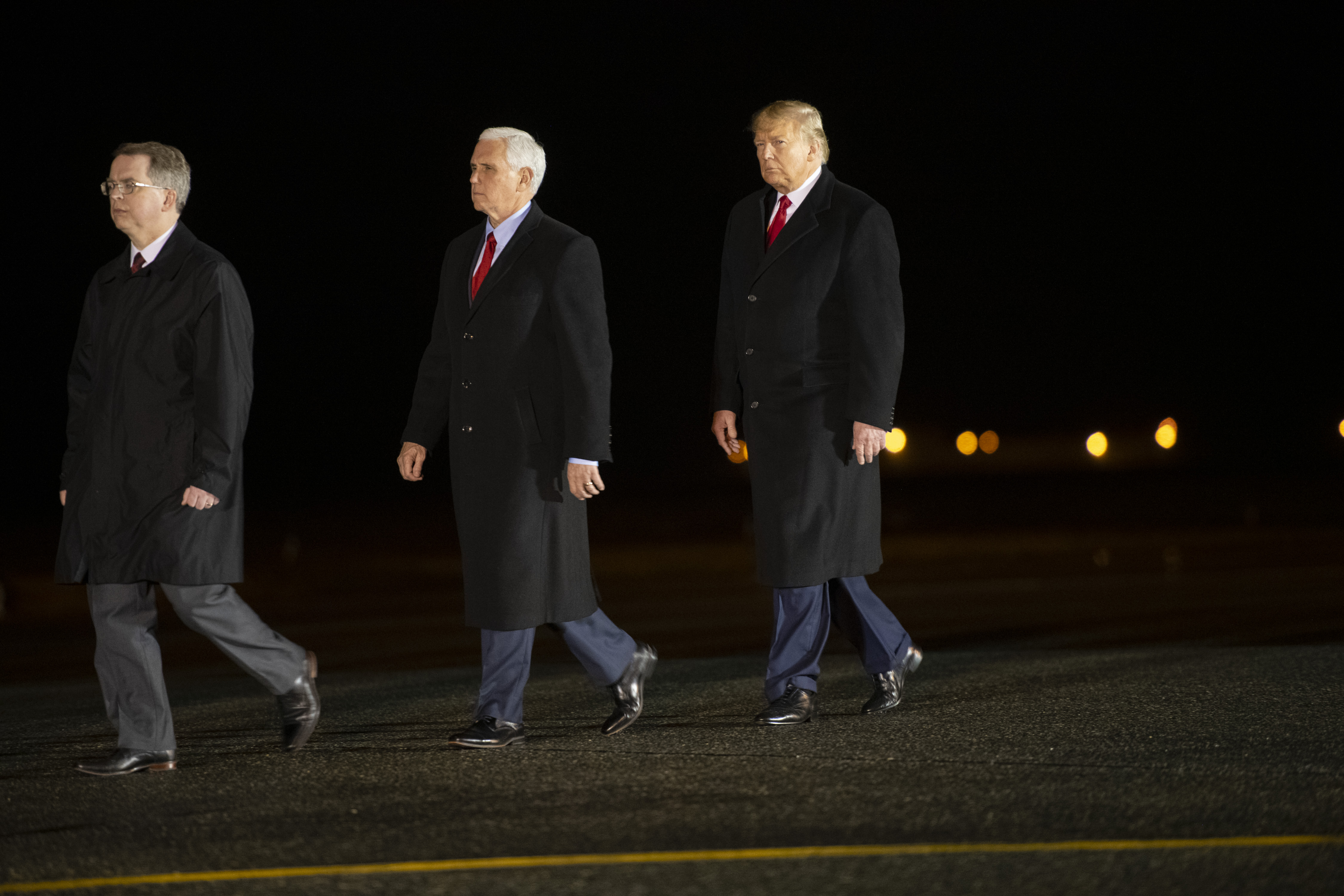 DOVER, DE - FEBRUARY 10: (R) U.S. President Donald J. Trump and (C) Vice President Mike Pence arrive at a dignified transfer for fallen service members, U.S. Army Sgt. 1st Class Javier J. Gutierrez, 28, U.S. Army Sgt. 1st Class Antonio R. Rodriguez, 28, at Dover Air Force Base on February 10, 2020 in Dover, Delaware. Both soldiers were killed in an attack in the Nangarhar province of Afghanistan on Saturday, according to a Department of Defense release. (Photo by Mark Makela/Getty Images)