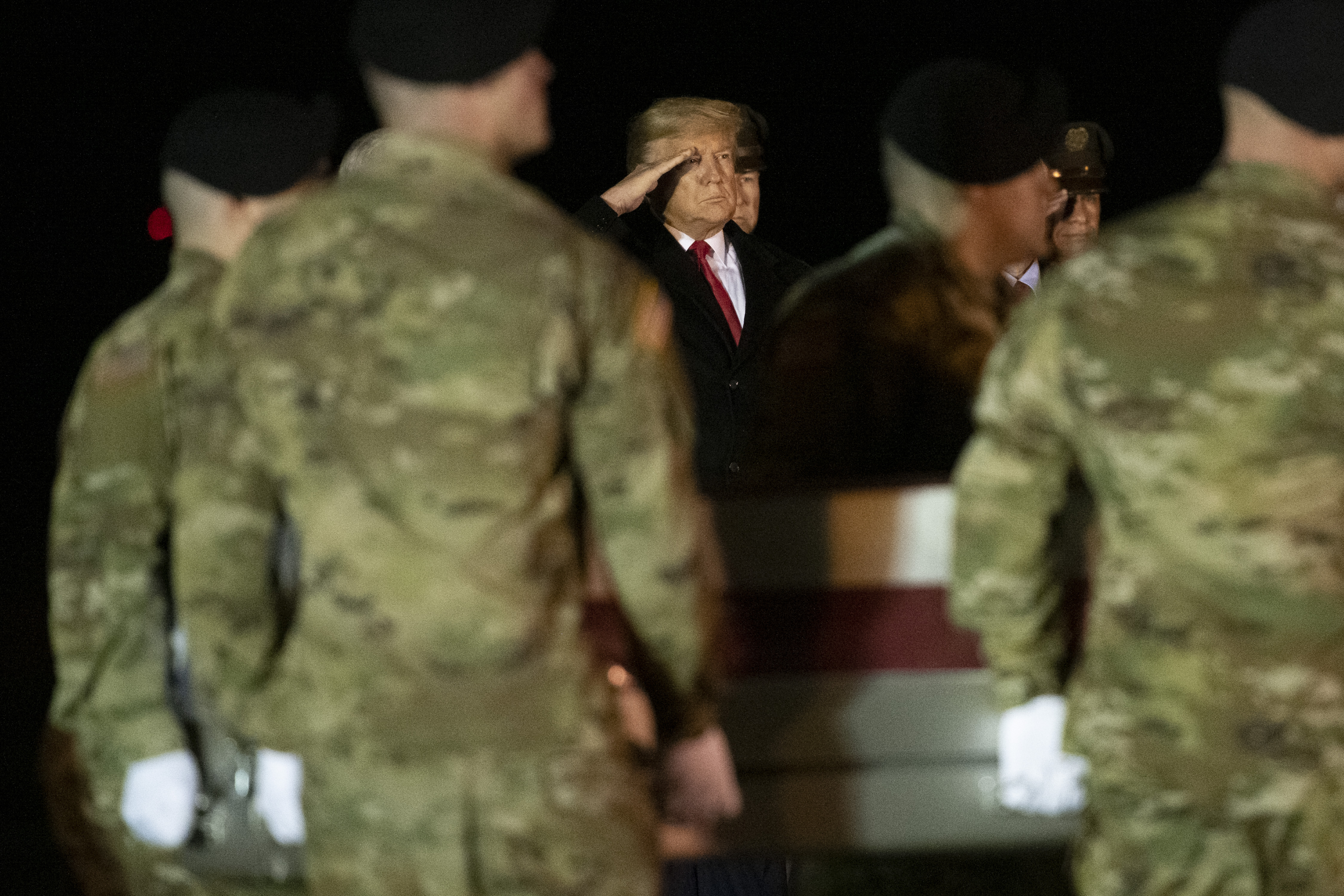 DOVER, DE - FEBRUARY 10: U.S. President Donald Trump watches as military personnel carry a transfer case for fallen service member, U.S. Army Sgt. 1st Class Javier J. Gutierrez, 28, during a dignified transfer at Dover Air Force Base on February 10, 2020 in Dover, Delaware. Gutierrez and U.S. Army Sgt. 1st Class Antonio R. Rodriguez were both killed in an attack in the Nangarhar province of Afghanistan on Saturday, according to a Department of Defense release. (Photo by Mark Makela/Getty Images)