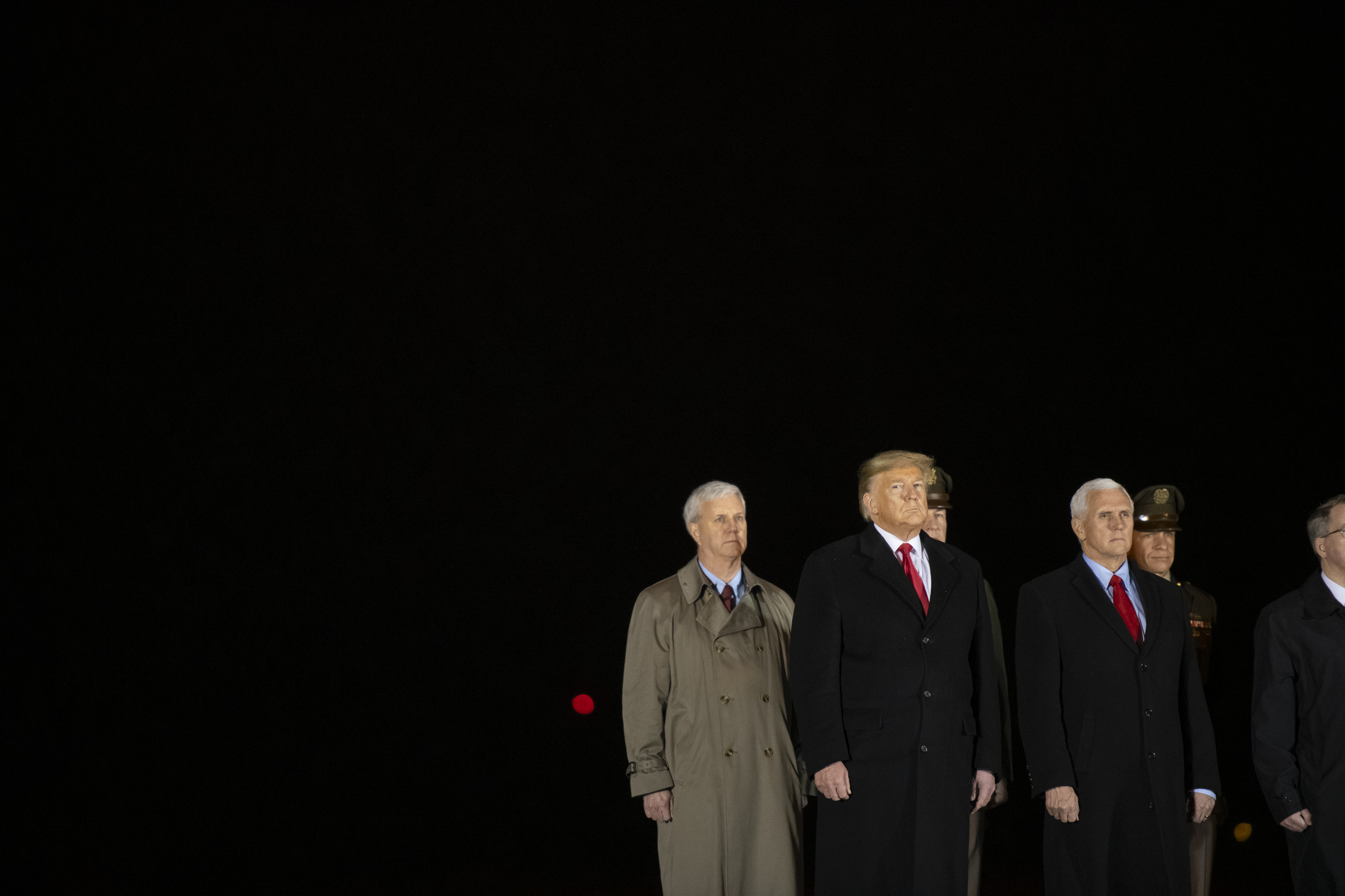 DOVER, DE - FEBRUARY 10: (2nd-L) U.S. President Donald Trump and Vice President Mike Pence attend a dignified transfer for fallen service members U.S. Army Sgt. 1st Class Javier J. Gutierrez, 28, and Army Sgt. 1st Class Antonio R. Rodriguez, 28, at Dover Air Force Base on February 10, 2020 in Dover, Delaware. Both soldiers were both killed in an attack in the Nangarhar province of Afghanistan on Saturday, according to a Department of Defense release. (Photo by Mark Makela/Getty Images)