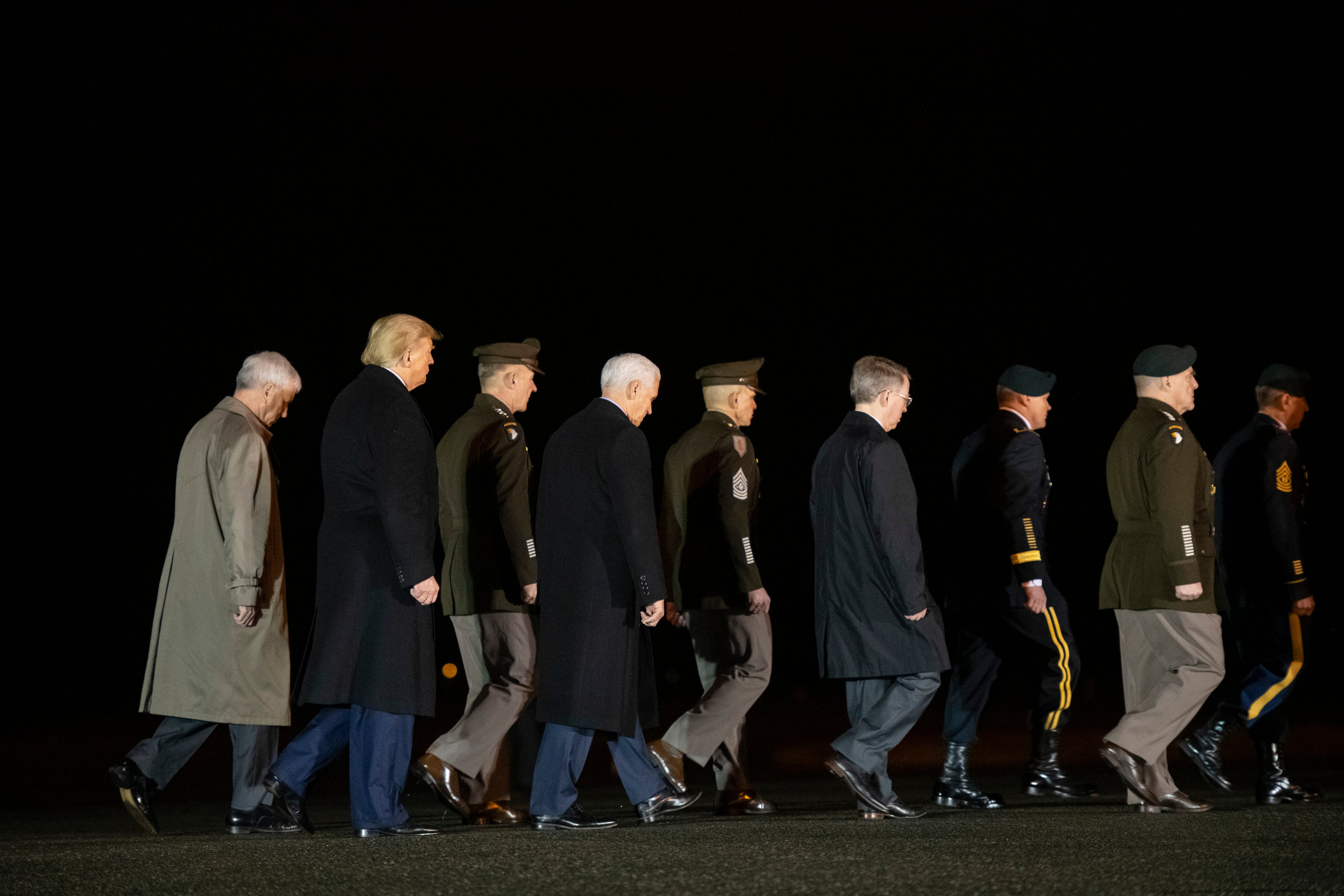 DOVER, DE - FEBRUARY 10: (2nd L) U.S. President Donald J. Trump and (4th L) Vice President Mike Pence depart attending a dignified transfer for fallen service members U.S. Army Sgt. 1st Class Javier J. Gutierrez, 28, and Army Sgt. 1st Class Antonio R. Rodriguez, 28, at Dover Air Force Base on February 10, 2020 in Dover, Delaware. Both soldiers were both killed in an attack in the Nangarhar province of Afghanistan on Saturday, according to a Department of Defense release. (Photo by Mark Makela/Getty Images)