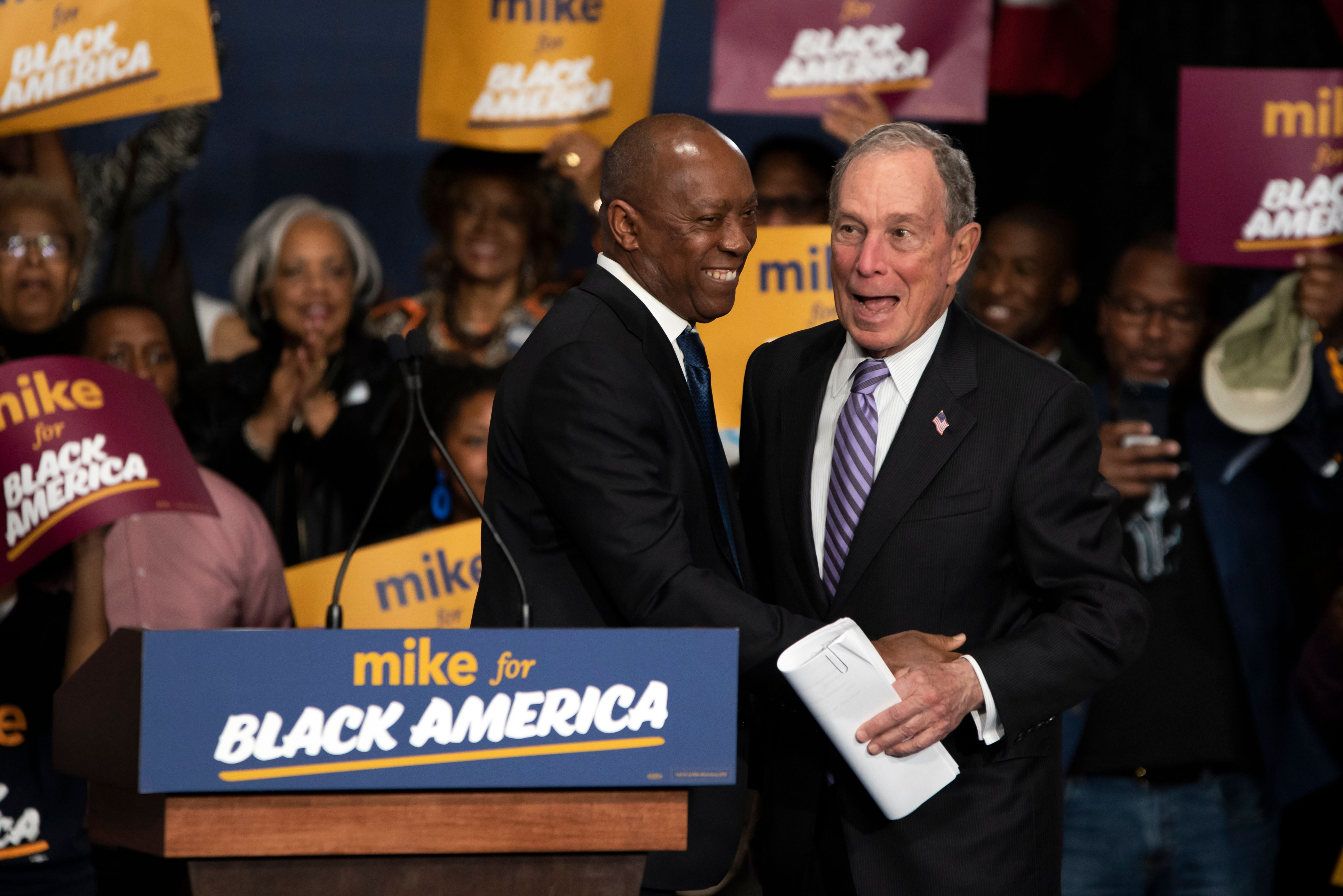 """Democratic presidential hopeful Mike Bloomberg (R) arrives to speak at the """"Mike for Black America Launch Celebration"""" at the Buffalo Soldier National Museum in Houston, Texas, on February 13, 2020. (MARK FELIX/AFP /AFP via Getty Images)"""
