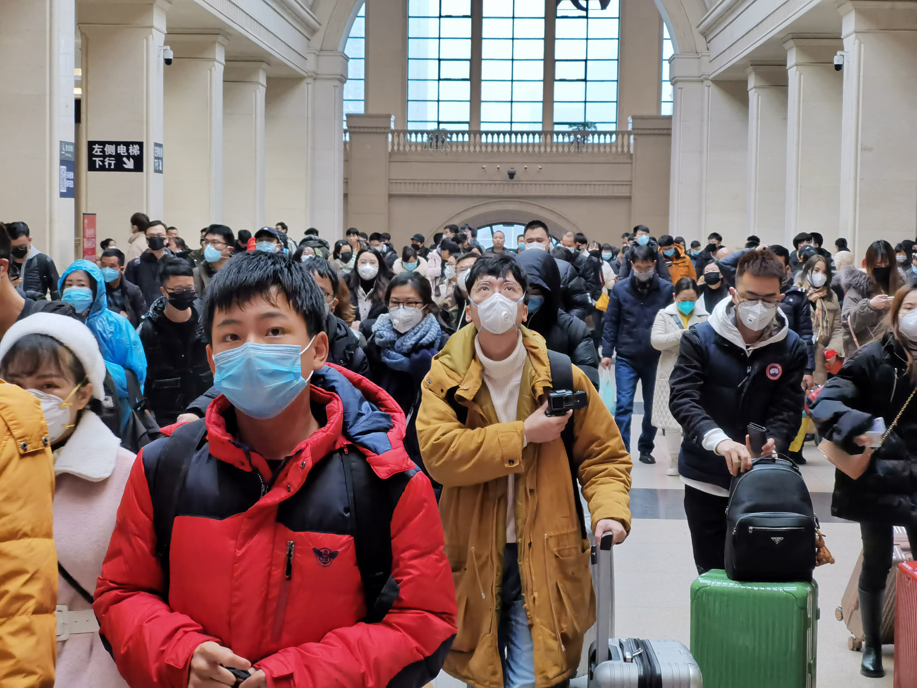 WUHAN, CHINA - JANUARY 22: People wear face masks as they wait at Hankou Railway Station on January 22, 2020 in Wuhan, China. A new infectious coronavirus known as