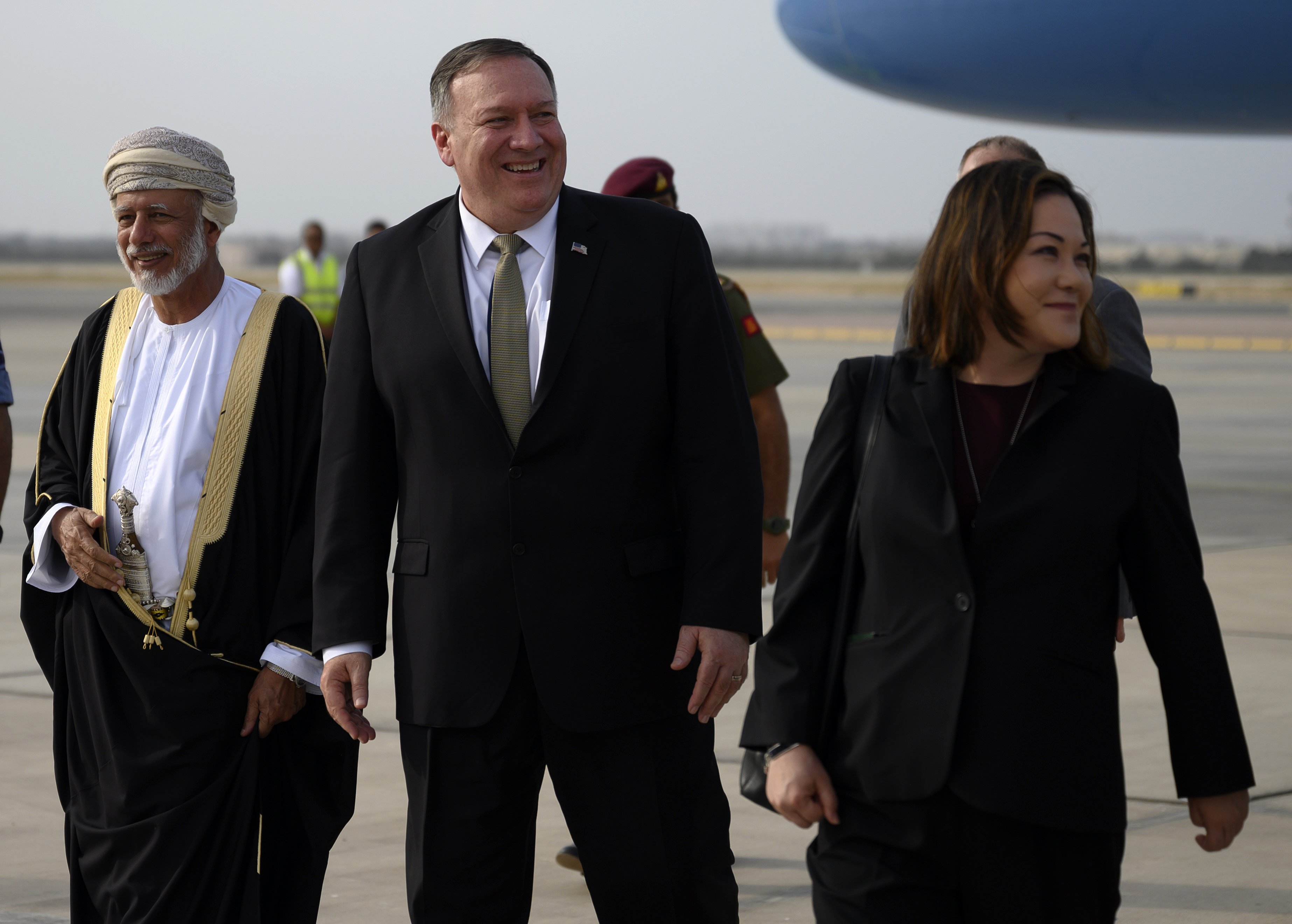 US Secretary of State Mike Pompeo (C) is greeted by Oman's Minister of Foreign Affairs Yusuf bin Alawi bin Abdullah (L) and US Ambassador to Oman Leslie Tsou (R) upon his arrival in the capital Muscat on February 21, 2020. (ANDREW CABALLERO-REYNOLDS/AFP via Getty Images)