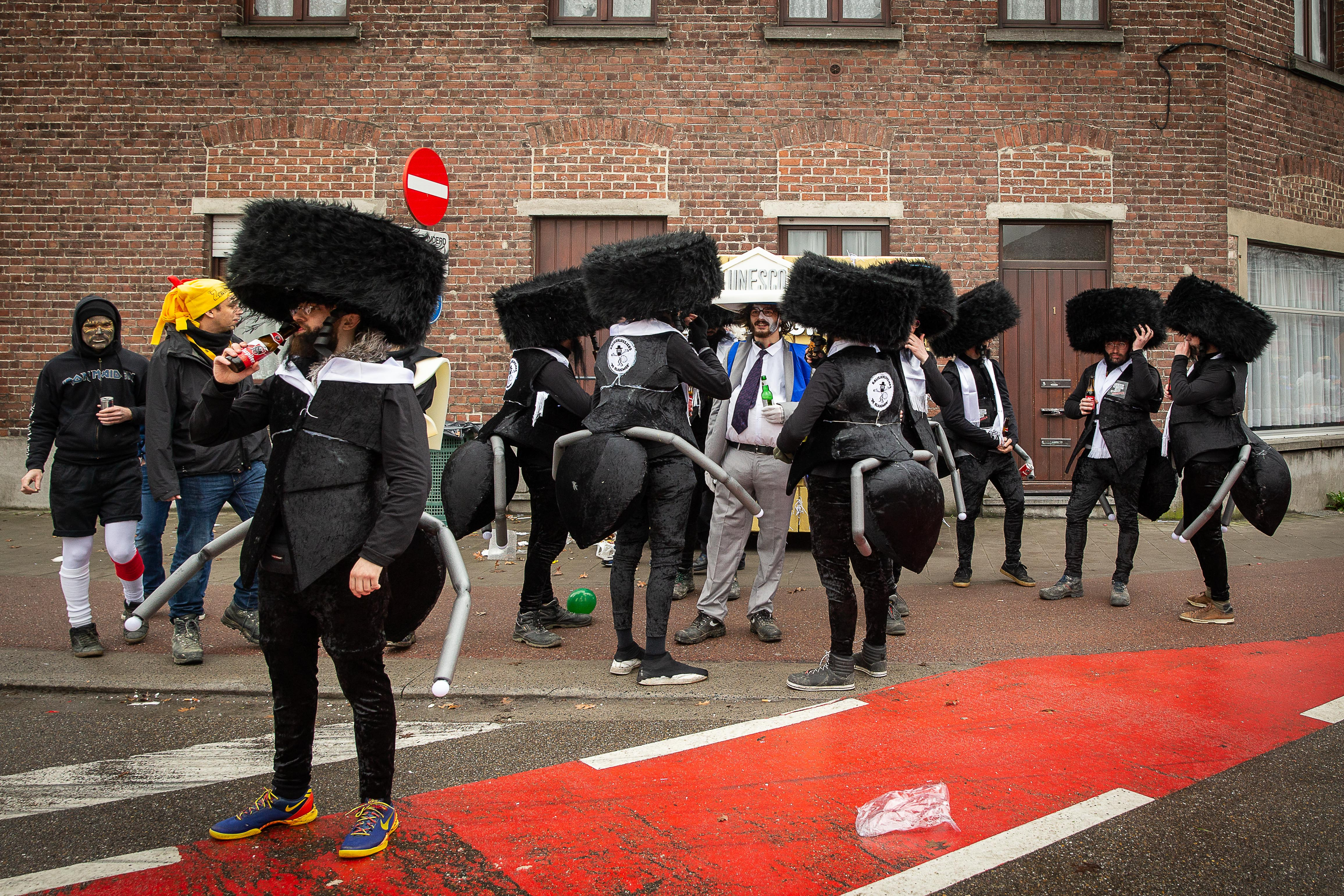 Revellers dressed as Ultra-Orthodox Jews are pictured prior the start of the Aalst Carnival's on February 23, 2020, (Photo by JAMES ARTHUR GEKIERE/AFP via Getty Images)