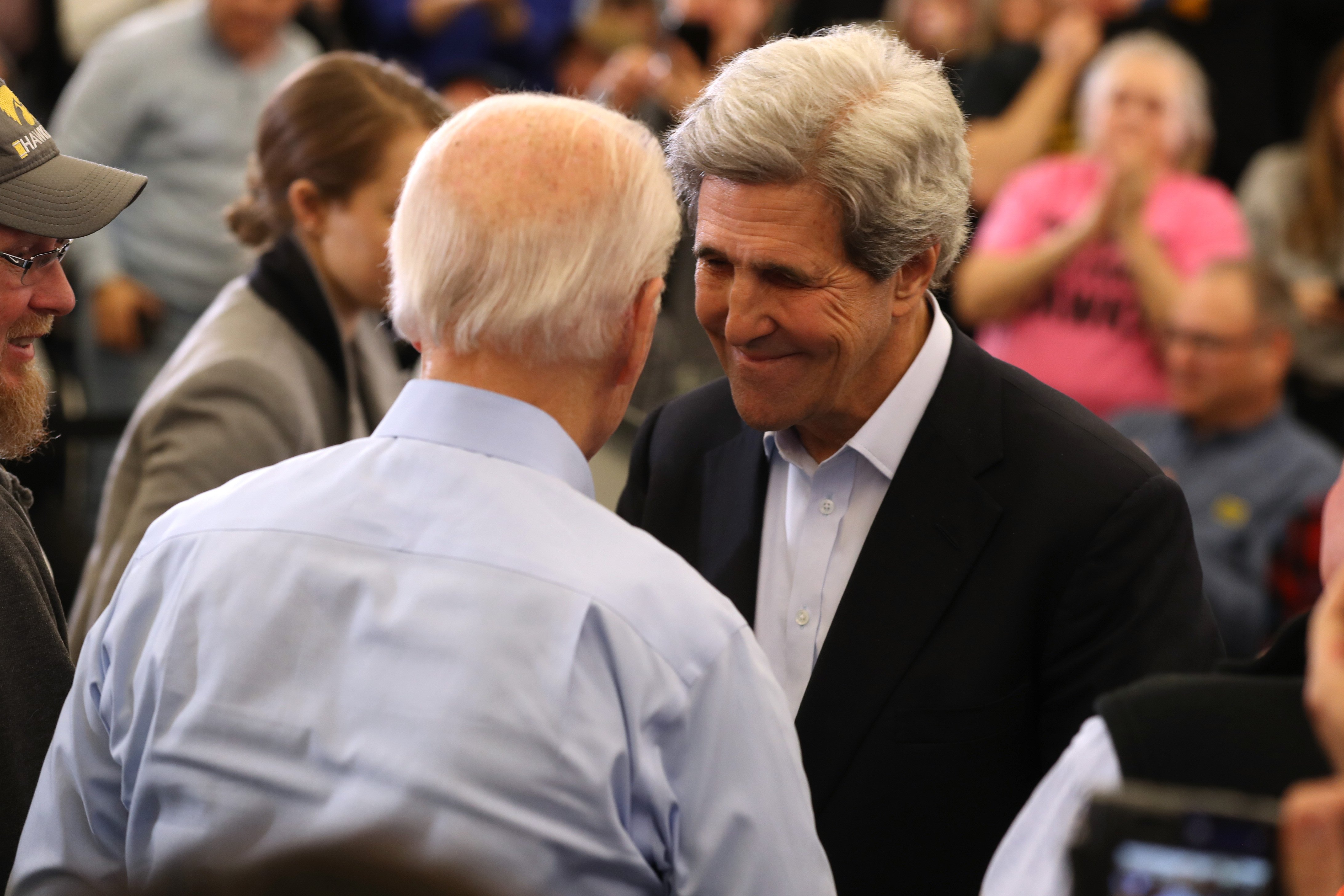 NORTH LIBERTY, IOWA - FEBRUARY 01: Former Secretary of State John Kerry (R) greets Democratic presidential candidate former Vice President Joe Biden during a campaign event on February 01, 2020 in North Liberty, Iowa. With two days to go before the 2020 Iowa Presidential caucuses, Joe Biden is campaigning across Iowa. (Photo by Justin Sullivan/Getty Images)