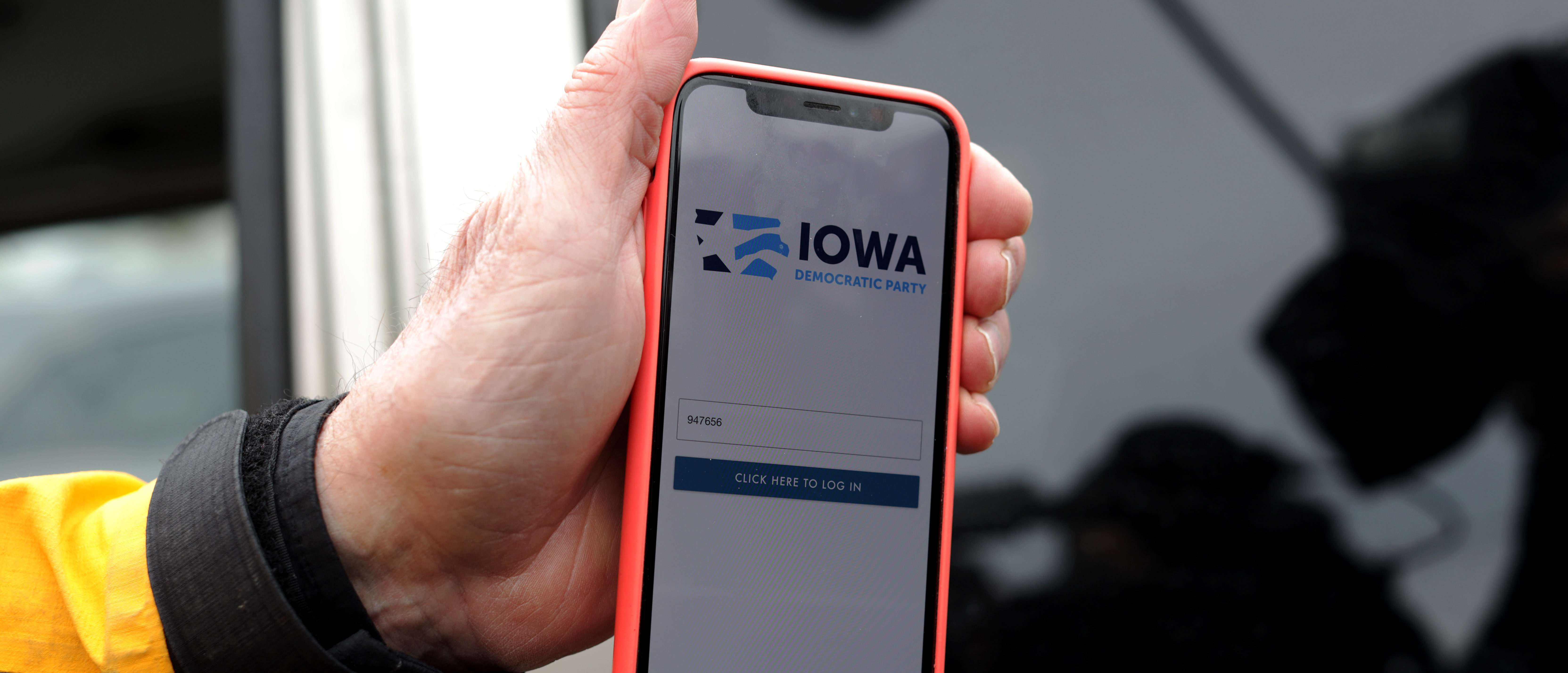 Carl Voss, Des Moines City Councilman and a precinct chair, shows photographers the app that was used for caucus results reporting on his phone after he unsuccessfully attempted to drop off a caucus results packet from Precinct 55 at the Iowa Democratic Party headquarters February 4, 2020 in Des Moines, Iowa. (Alex Wong/Getty Images)