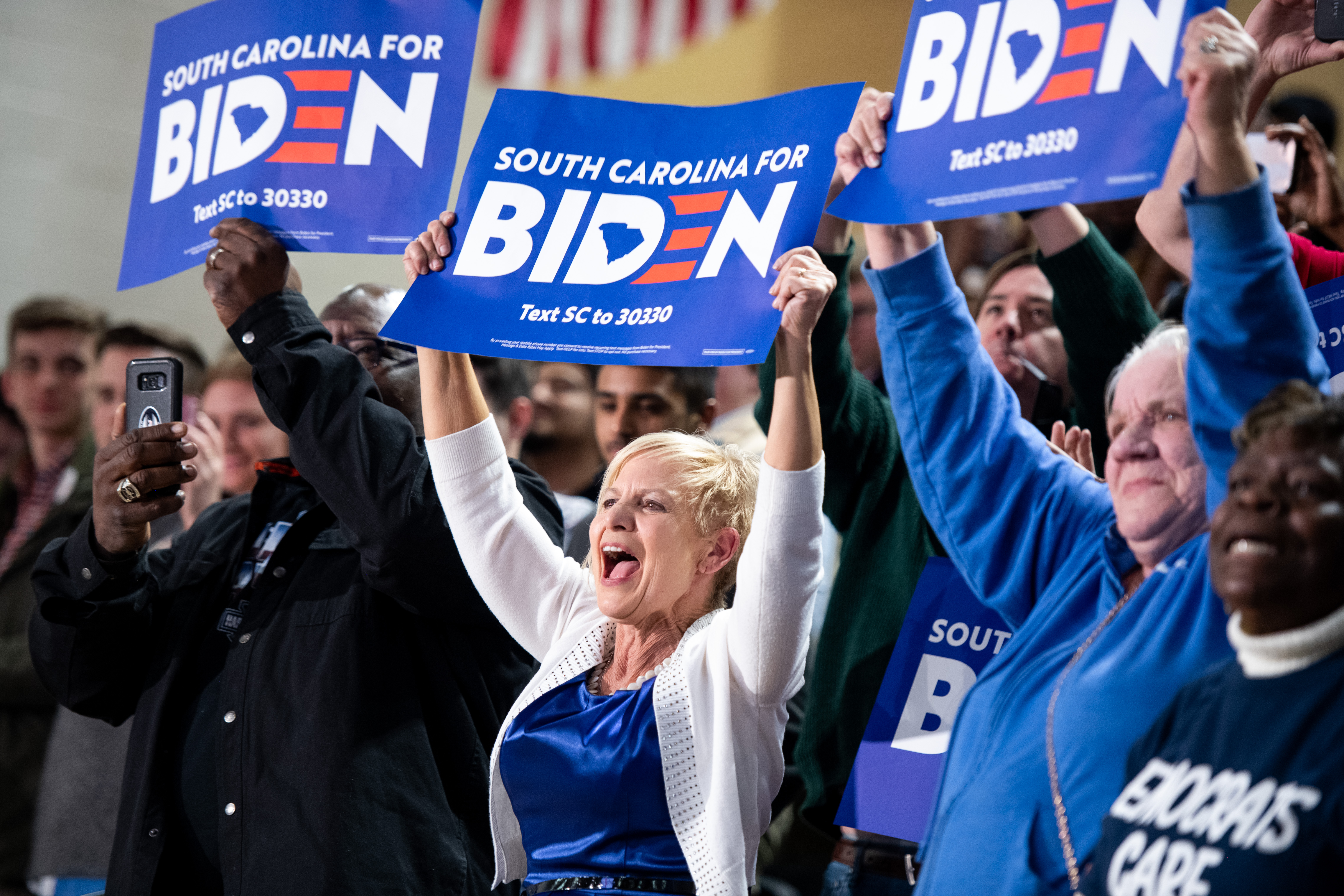 SPARTANBURG, SC - FEBRUARY 28: Harriett Phillips (C) cheers for Democratic presidential candidate former Vice President Joe Biden at Wofford University February 28, 2020 in Spartanburg, South Carolina. South Carolinians will vote in the Democratic presidential primary tomorrow. (Photo by Sean Rayford/Getty Images)