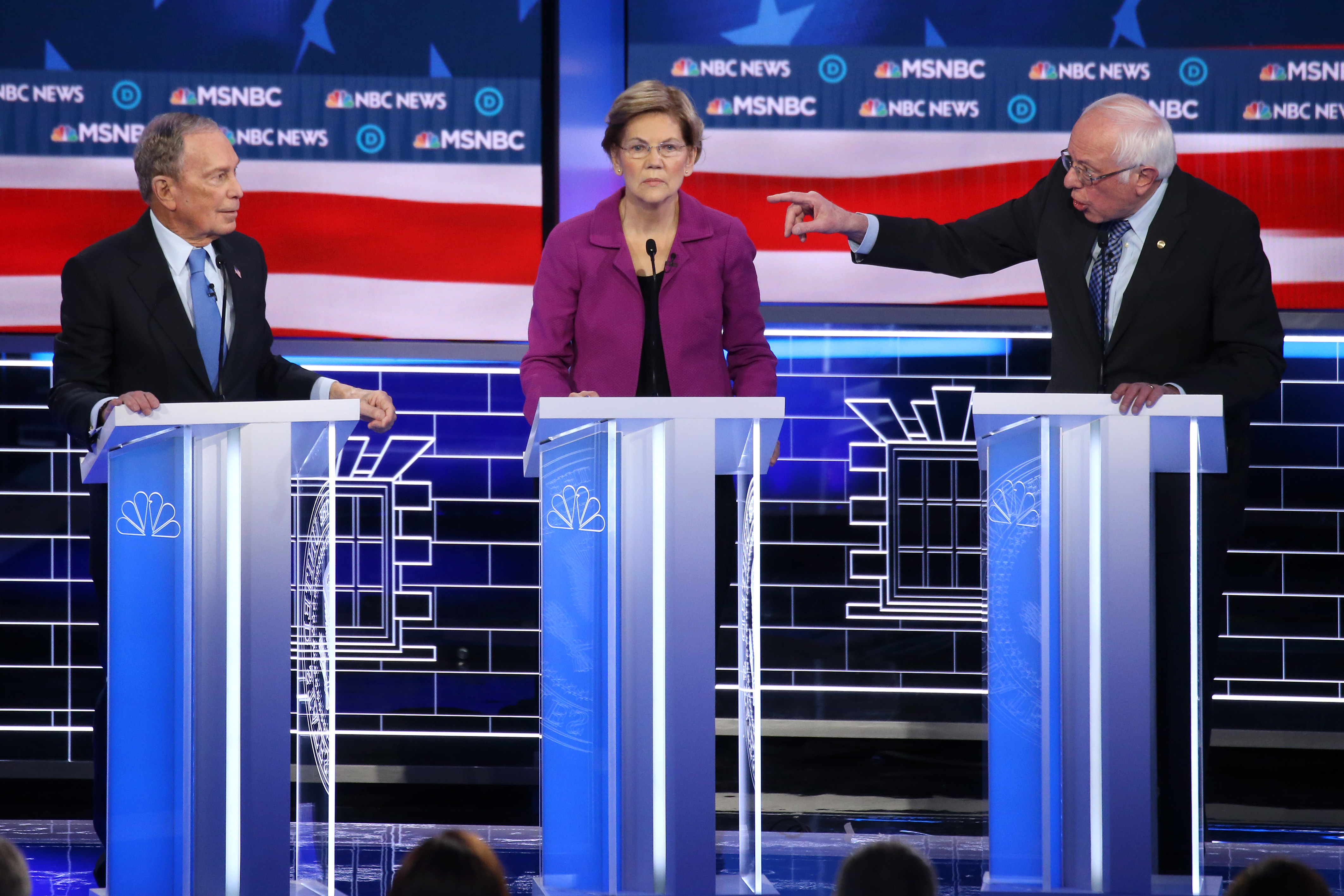 LAS VEGAS, NEVADA - FEBRUARY 19: Democratic presidential candidate Sen. Bernie Sanders (I-VT) (R) gestures as Sen. Elizabeth Warren (D-MA) and former New York City mayor Mike Bloomberg listen during the Democratic presidential primary debate at Paris Las Vegas on February 19, 2020 in Las Vegas, Nevada. Six candidates qualified for the third Democratic presidential primary debate of 2020, which comes just days before the Nevada caucuses on February 22. (Photo by Mario Tama/Getty Images)