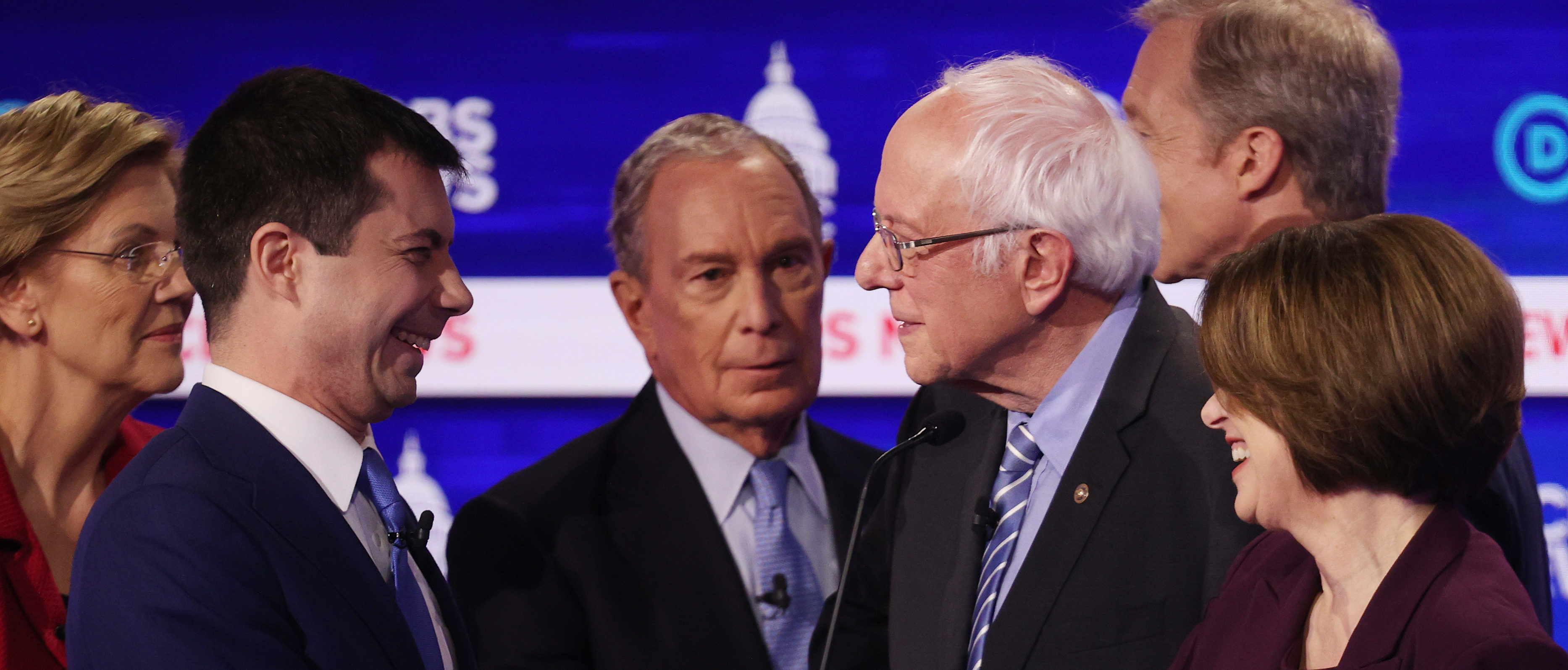 CHARLESTON, SOUTH CAROLINA - FEBRUARY 25: Democratic presidential candidates Sen. Elizabeth Warren (D-MA), former South Bend, Indiana Mayor Pete Buttigieg, former New York City Mayor Mike Bloomberg, Sen. Bernie Sanders (I-VT), Sen. Amy Klobuchar (D-MN), and Tom Steyer speak after the Democratic presidential primary debate at the Charleston Gaillard Center on February 25, 2020 in Charleston, South Carolina. Seven candidates qualified for the debate, hosted by CBS News and Congressional Black Caucus Institute, ahead of South Carolina's primary in four days. (Photo by Win McNamee/Getty Images)