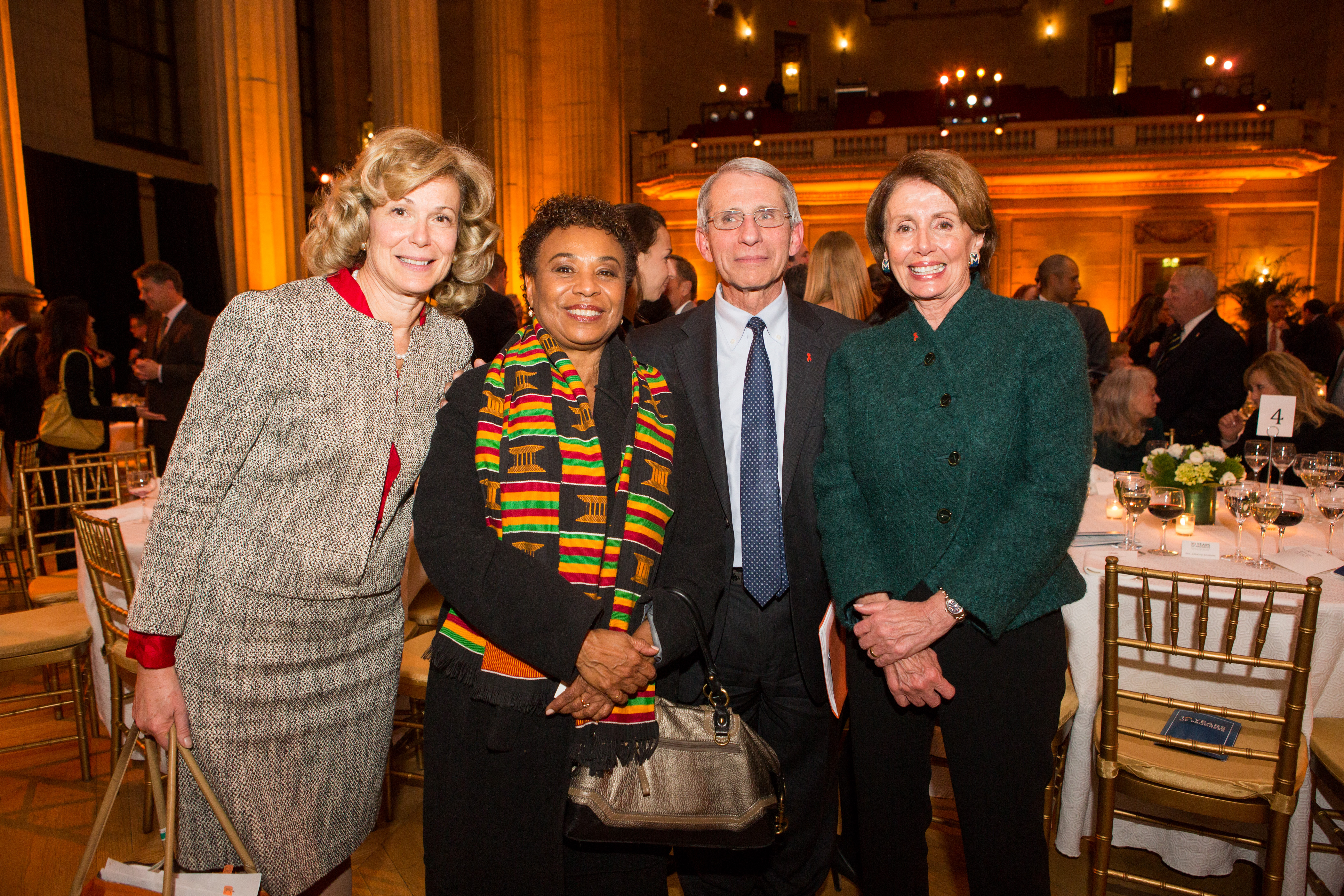 WASHINGTON, DC - DECEMBER 2: L to R, Debbie Birx, Ambassador at Large and Coordinator of US Government Activities to Combat HIV/AIDS, Rep. Barbara Lee (D-CA), Dr. Anthony Fauci, an immunologist and leading HIV/AIDS researcher, and Rep. Nancy Pelosi (D-CA), U.S. House Minority Leader, pose for a photo at the 10th anniversary leadership gala of the Friends Of The Global Fight Against AIDS, Tuberculosis and Malaria, December 2, 2014 in Washington, DC. Klein is board chair of the non-profit organization. (Photo by Allison Shelley/Getty Images for Friends of the Global Fight)