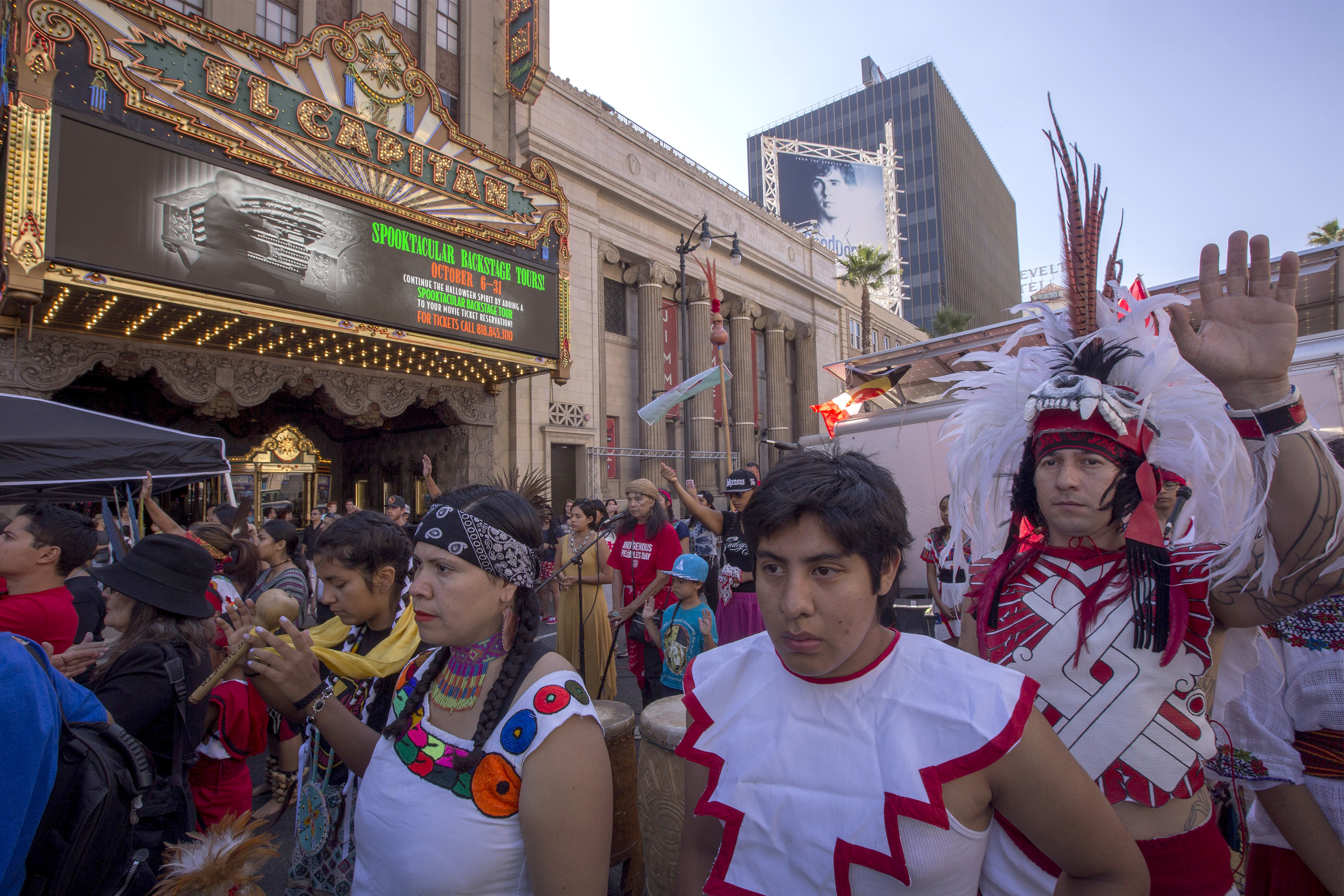 Dancers from Anahuacalmecac International University Preparatory of North America school for indigenous students pray before dancing on Hollywood Boulevard (Photo by David McNew/Getty Images)