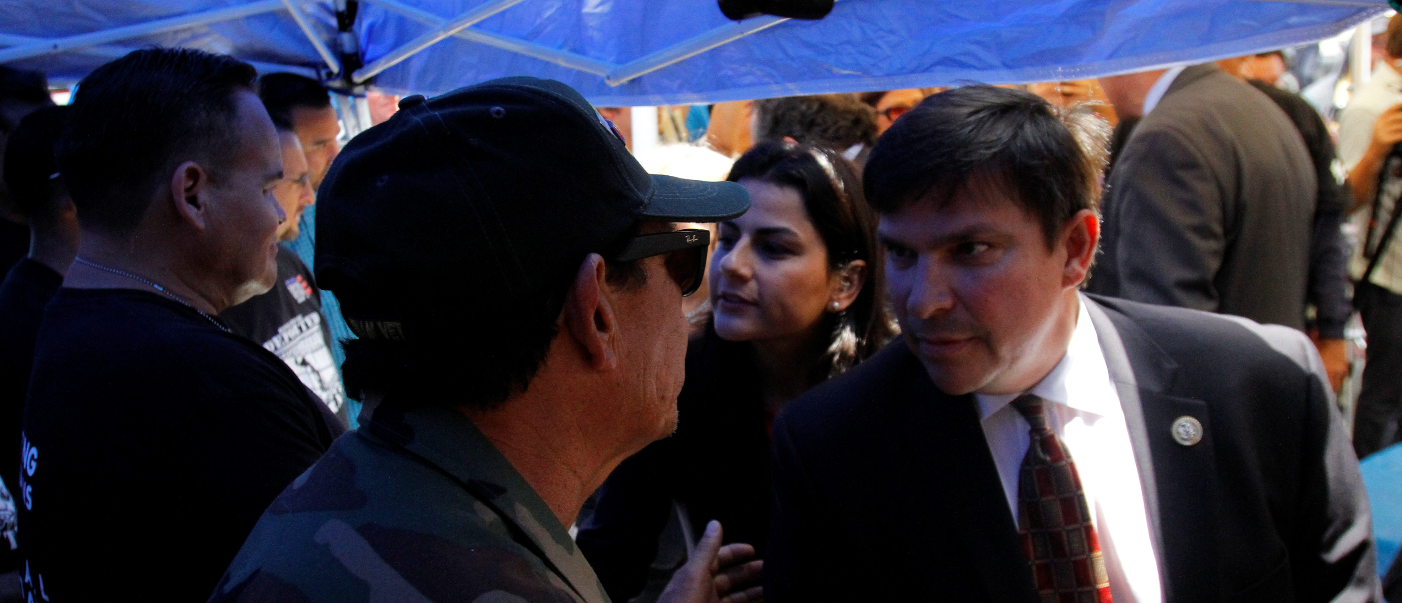 U.S. congressmen Vicente Gonzalez speaks with a Mexican veteran who have been deported from the United States, during a meeting outside the Deported Veterans Support House, in Tijuana