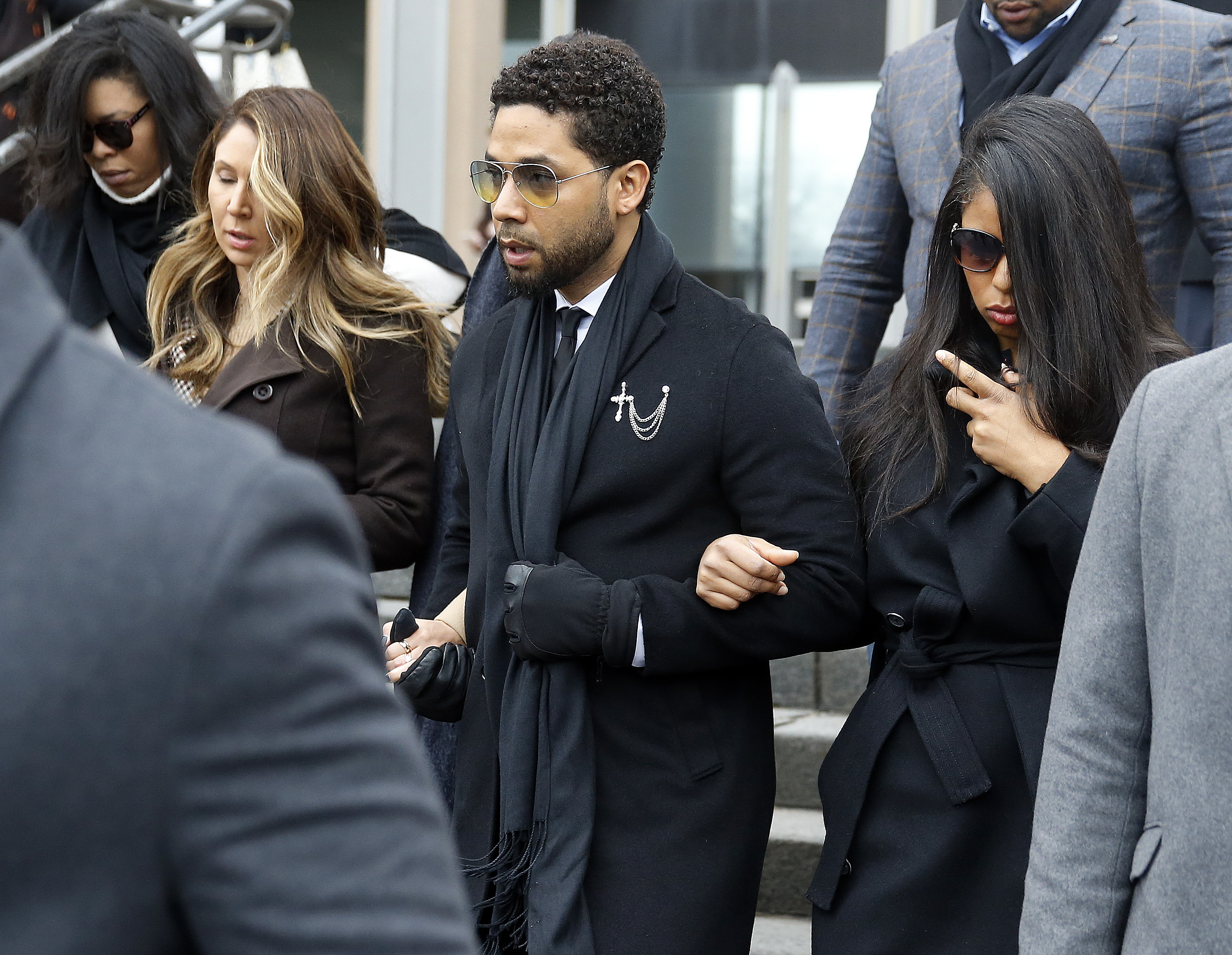 Flanked by attorneys and supporters, actor Jussie Smollett walks out of the Leighton Criminal Courthouse today after pleading not guilty to a new indictment on February 24, 2020 in Chicago, Illinois. (Photo by Nuccio DiNuzzo/Getty Images)