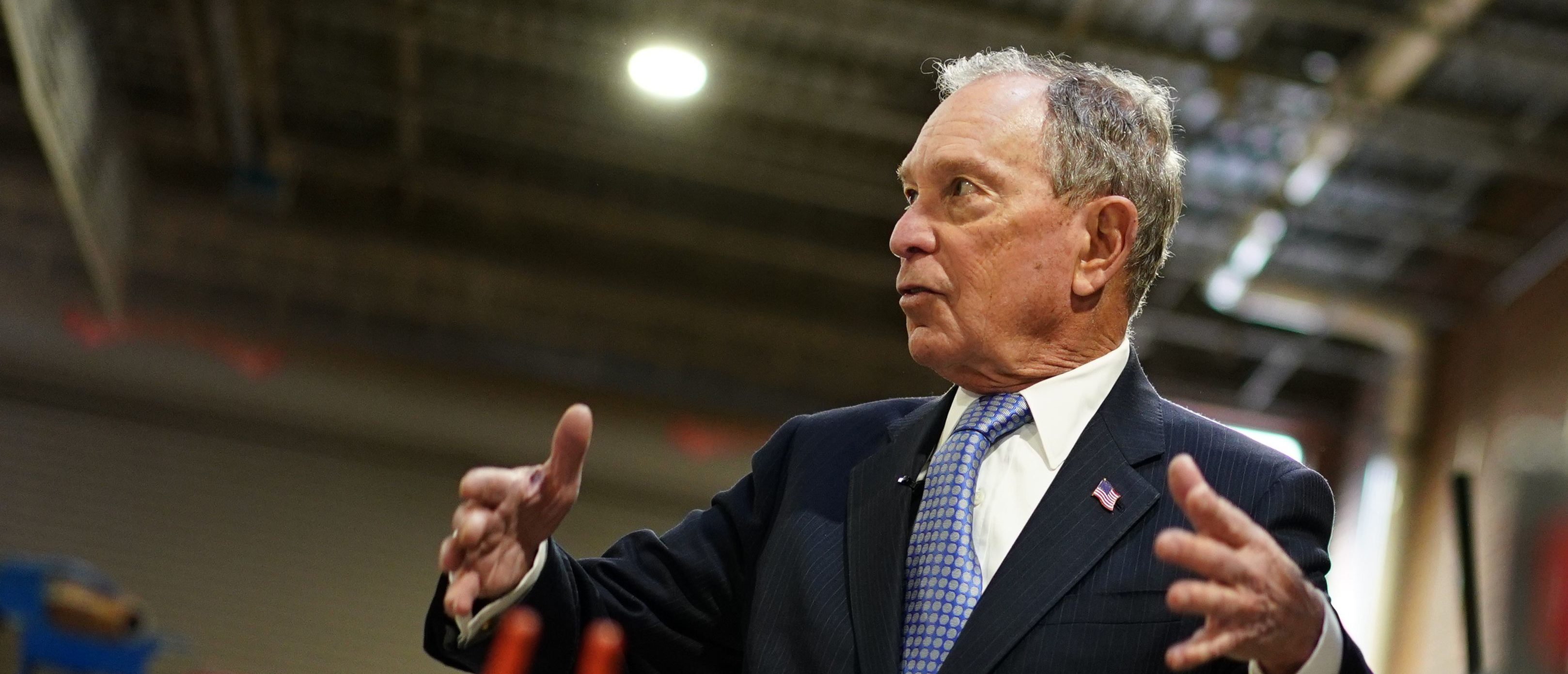 """U.S. Democratic presidential candidate Mike Bloomberg speaks while visiting """"Building Momentum,"""" a veteran owned business in Alexandria, Virginia on Feb. 7, 2020. (Photo by Mandel Ngan / AFP) (Photo by MANDEL NGAN/AFP via Getty Images)"""