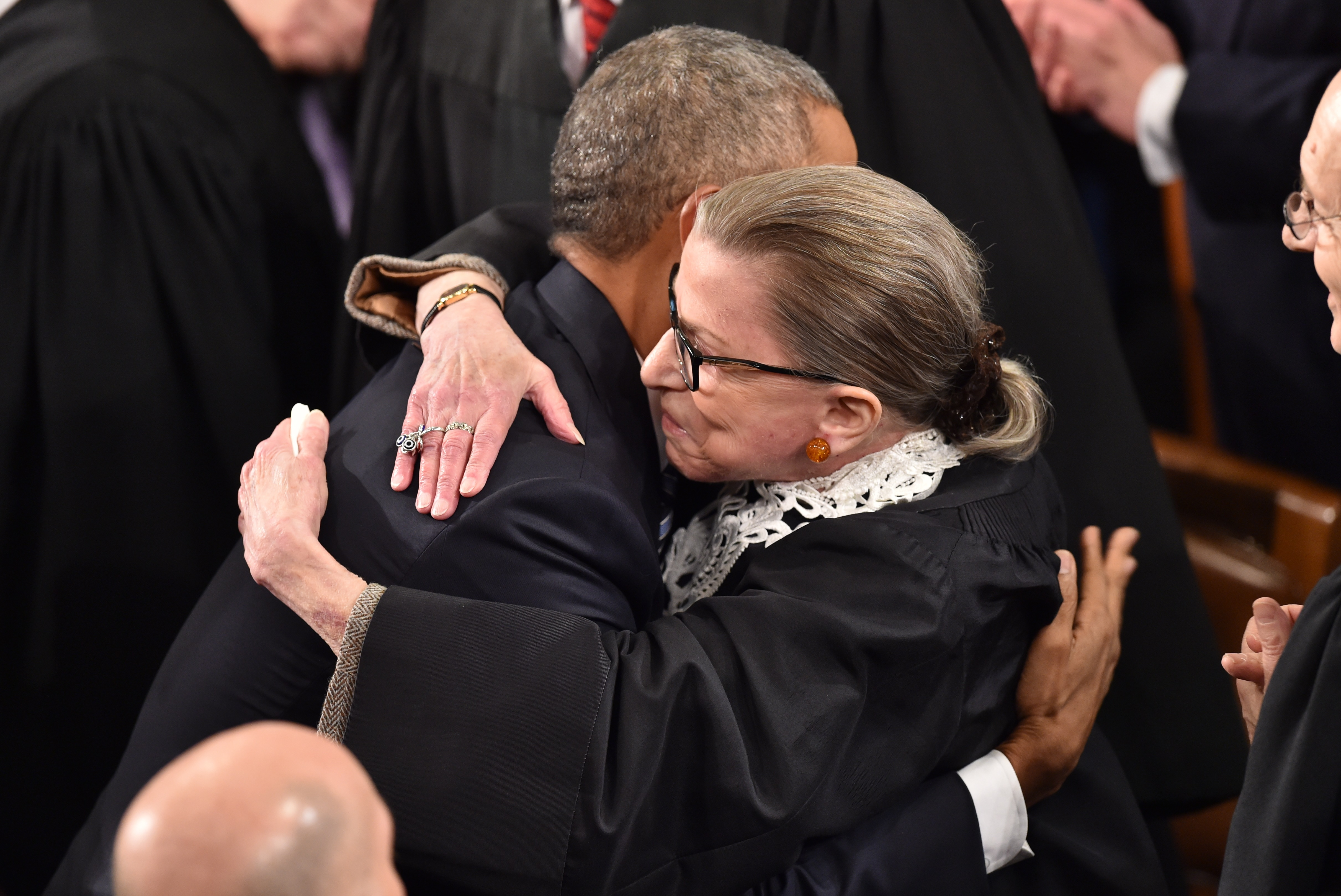 President Barack Obama greets Justice Ruth Bader Ginsburg as he arrives to deliver the State of the Union address on January 12, 2016. (Nicholas Kamm/AFP/Getty Images)
