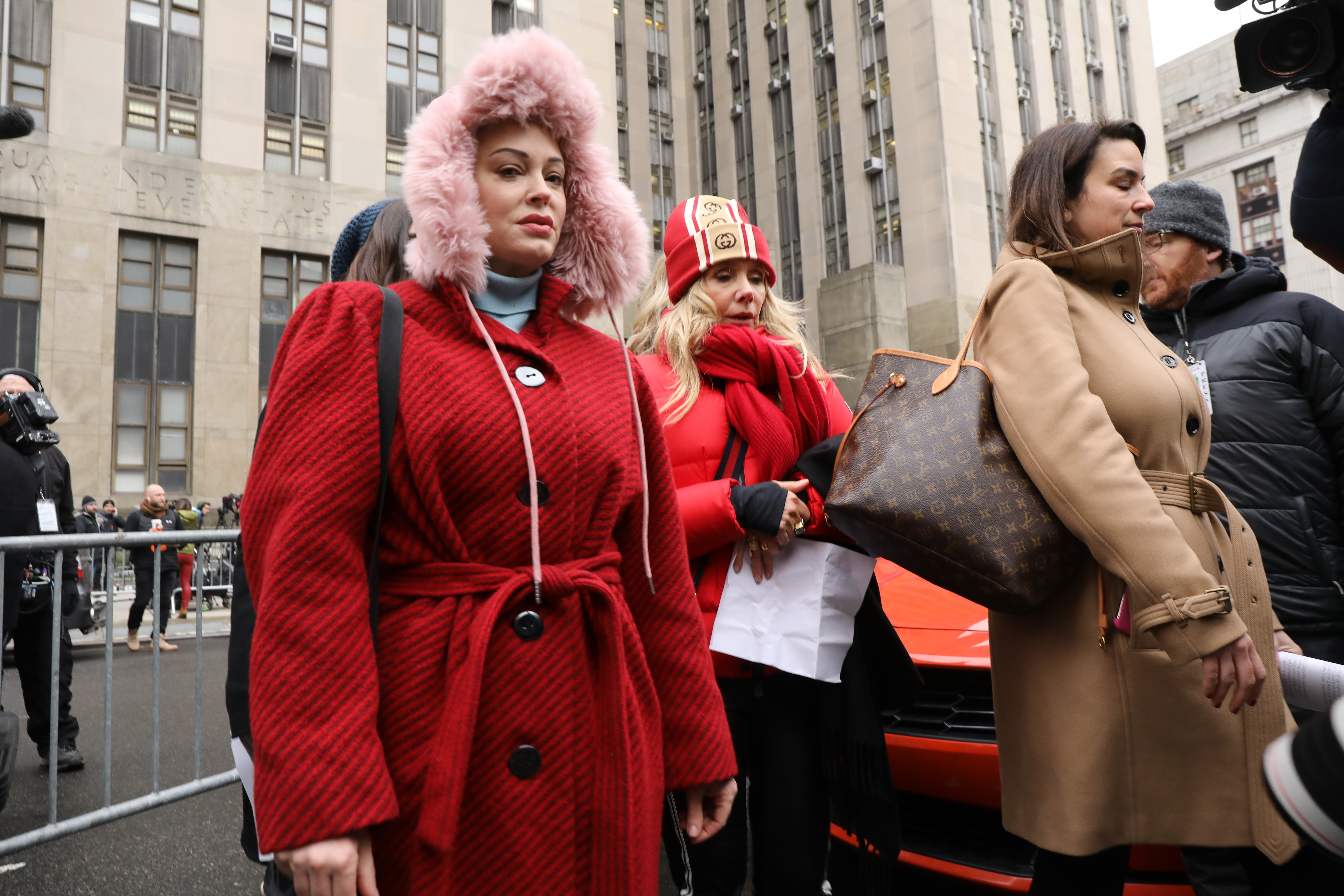 Actress Rose McGowan, who accused Weinstein of raping her more two two decades ago and then of destroying her career, joins other accusers and protesters as Harvey Weinstein arrives at a Manhattan court house for the start of his trial on January 06, 2020 in New York City. Weinstein, a movie producer whose alleged sexual misconduct helped spark the #MeToo movement, pleaded not-guilty on five counts of rape and sexual assault against two unnamed women and faces a possible life sentence in prison. (Photo by Spencer Platt/Getty Images)