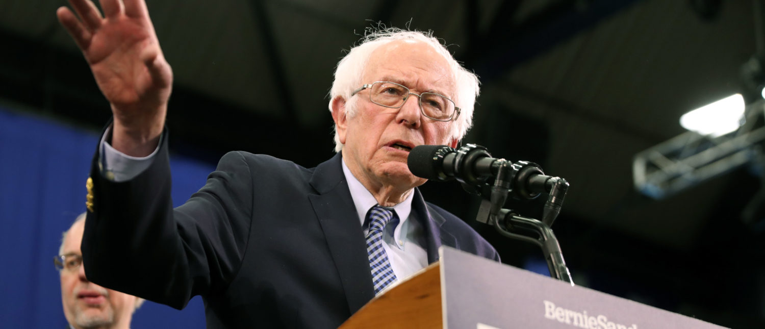Democratic presidential candidate Sen. Bernie Sanders speaks on stage during a primary night event on Feb. 11, 2020 in Manchester, New Hampshire. (Photo by Joe Raedle/Getty Images)