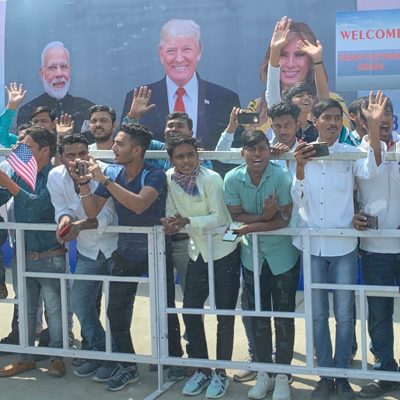 Indian citizens cheer as Trump's motorcade passes during his trip February 24, 2020. (White House Press Pool)