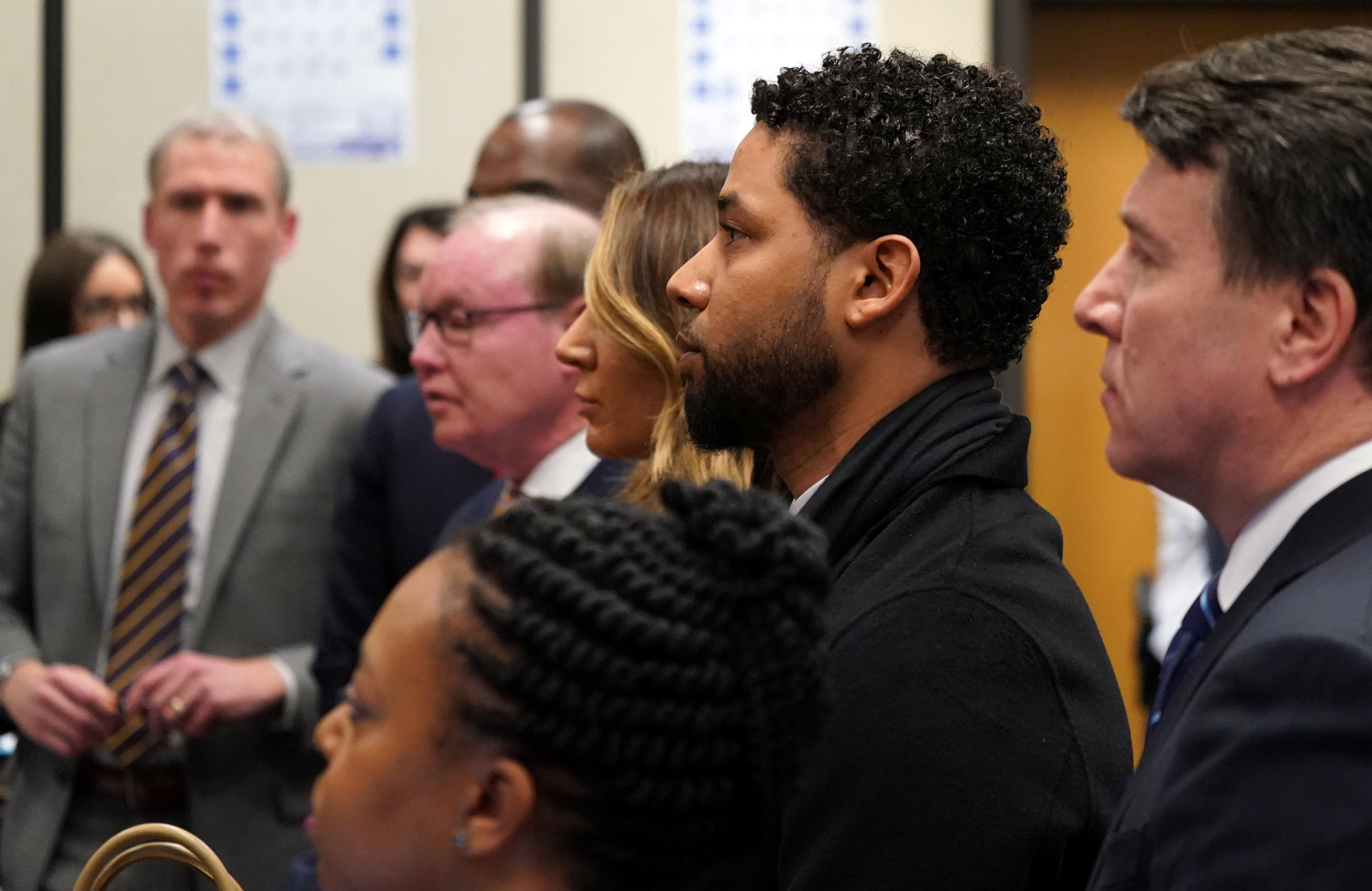 """Former """"Empire"""" actor Jussie Smollett appears in a courtroom at the Leighton Criminal Court Building for his arraignment, in Chicago, Illinois, U.S., Feb. 24, 2020. Brian Cassella/Pool via REUTERS"""
