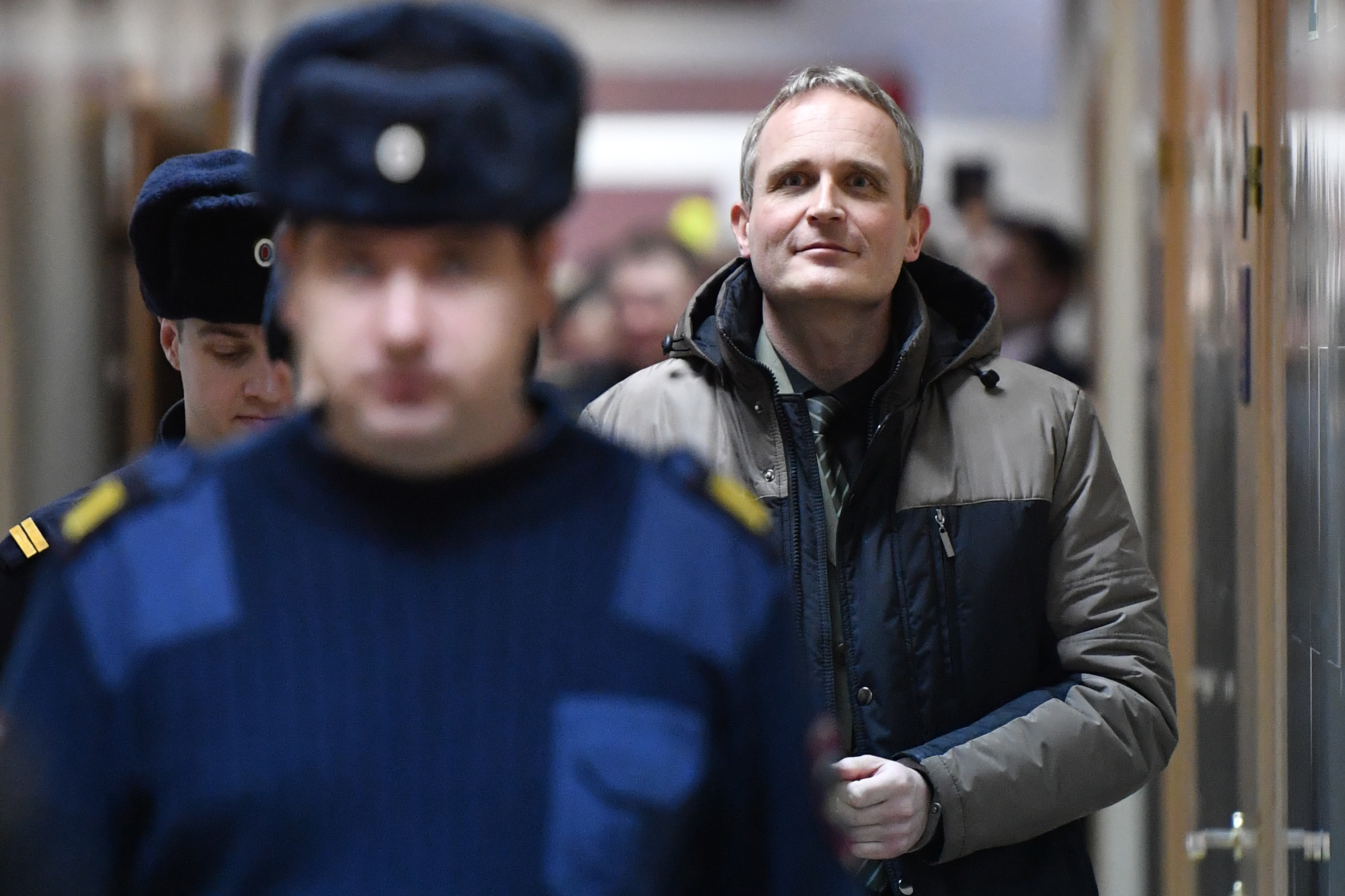 Dennis Christensen is escorted inside a courthouse following the verdict announcement in the town of Oryol on February 6, 2019. (MLADEN ANTONOV/AFP via Getty Images)