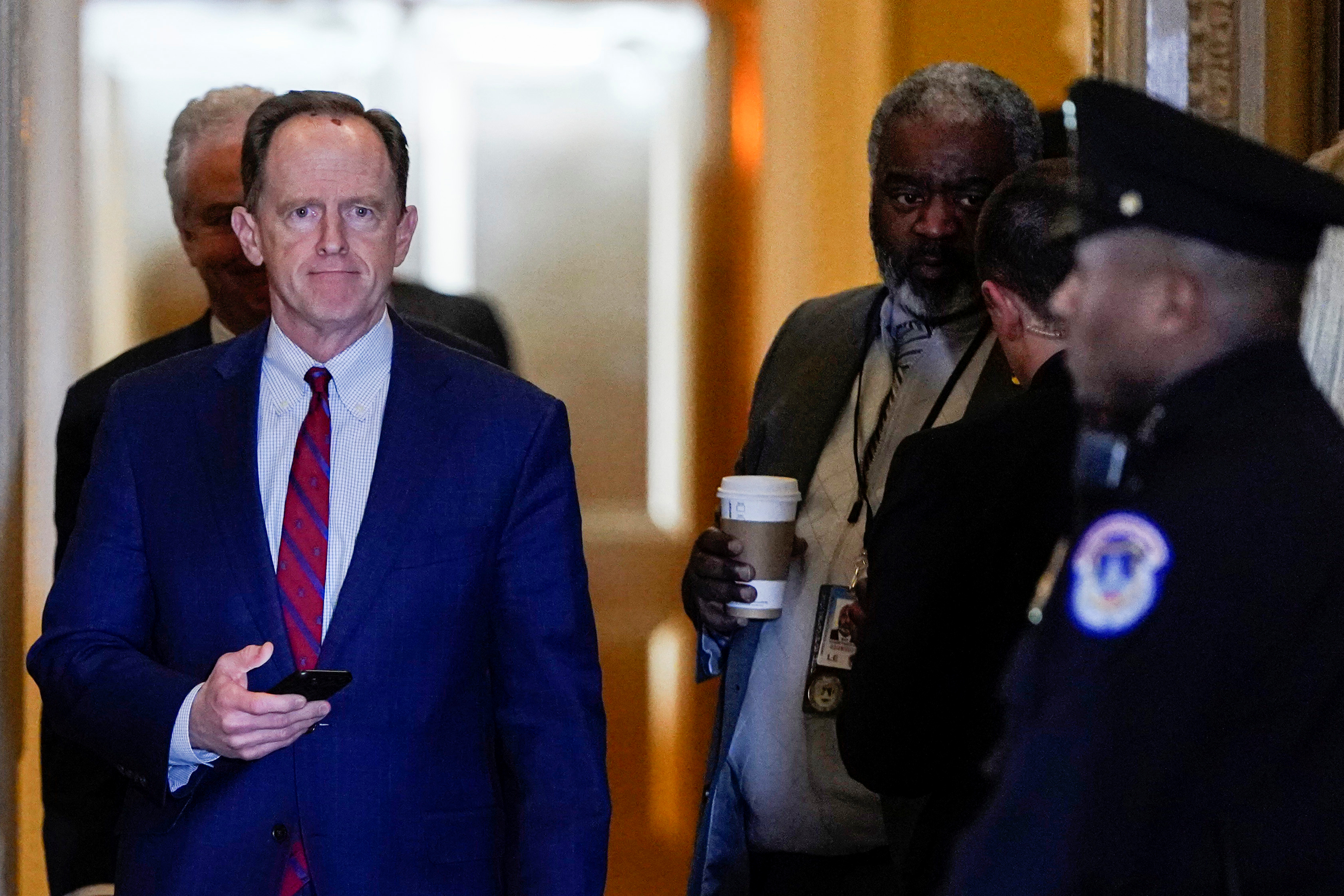 Senator Pat Toomey (R-PA) returns to the Senate Chamber after a break as the impeachment trial of U.S. President Donald Trump continues in Washington, U.S., Jan. 23, 2020. REUTERS/Joshua Roberts