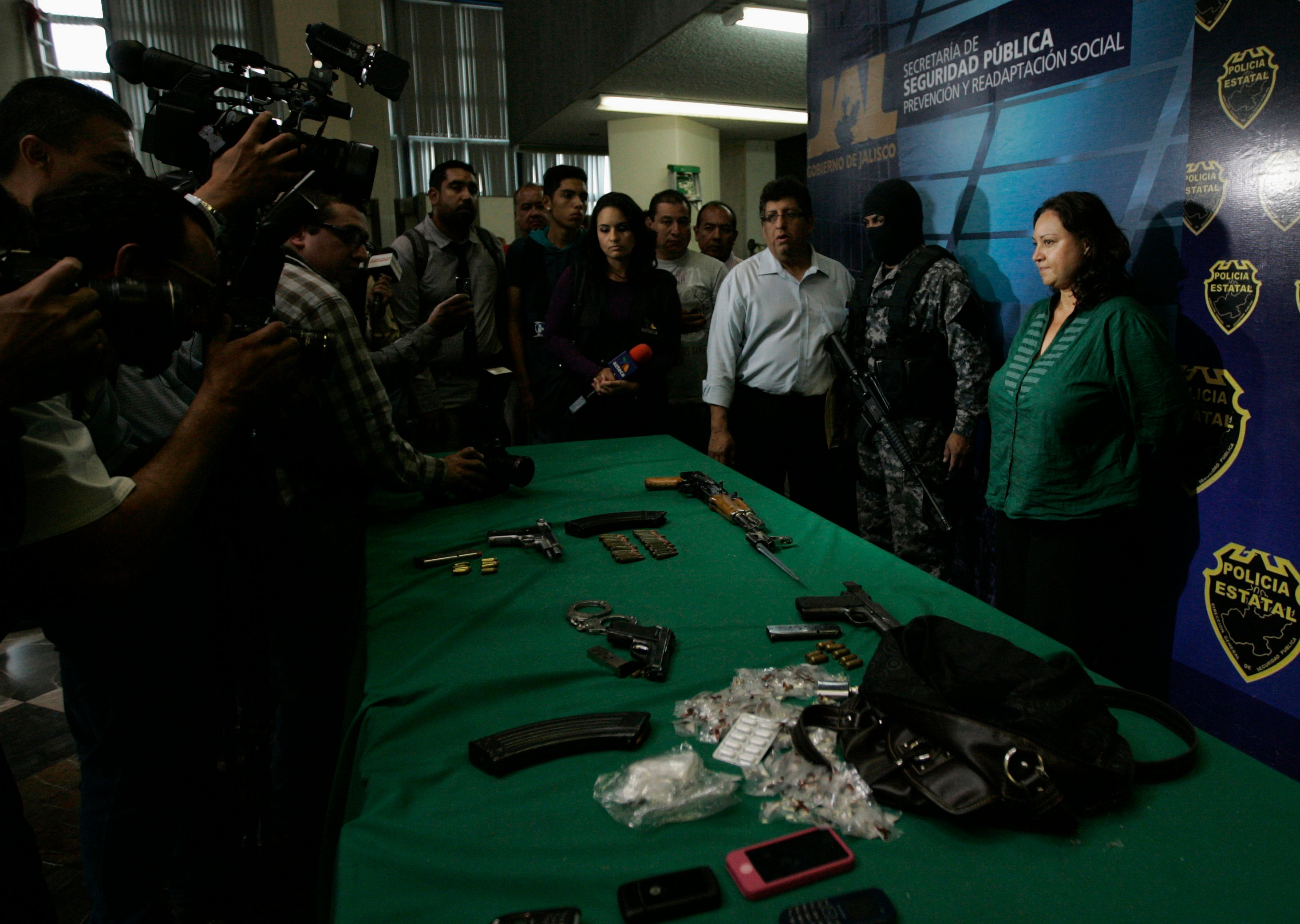 Carrillo Ochoa, leader of the Jalisco Nueva Generacion criminal cartel (CJNG) in the state of Jalisco, looks on as she is presented to the media in Guadalajara