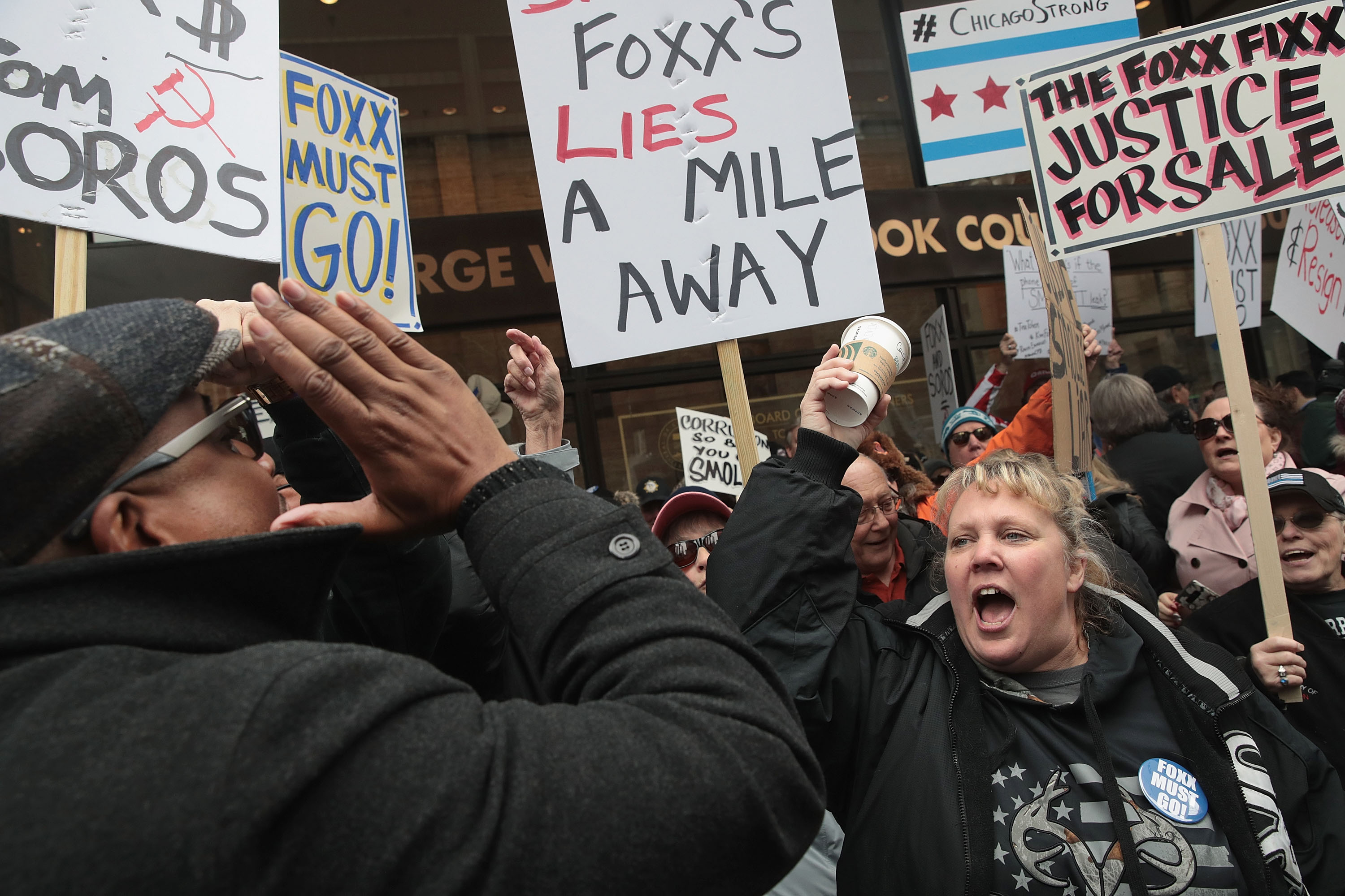 Supporters of Cook County State's Attorney Kim Foxx (L) argue with protestors during a demonstration organized by the Fraternal Order of Police to call for Foxx's removal on April 01, 2019 in Chicago, Illinois. (Scott Olson/Getty Images)