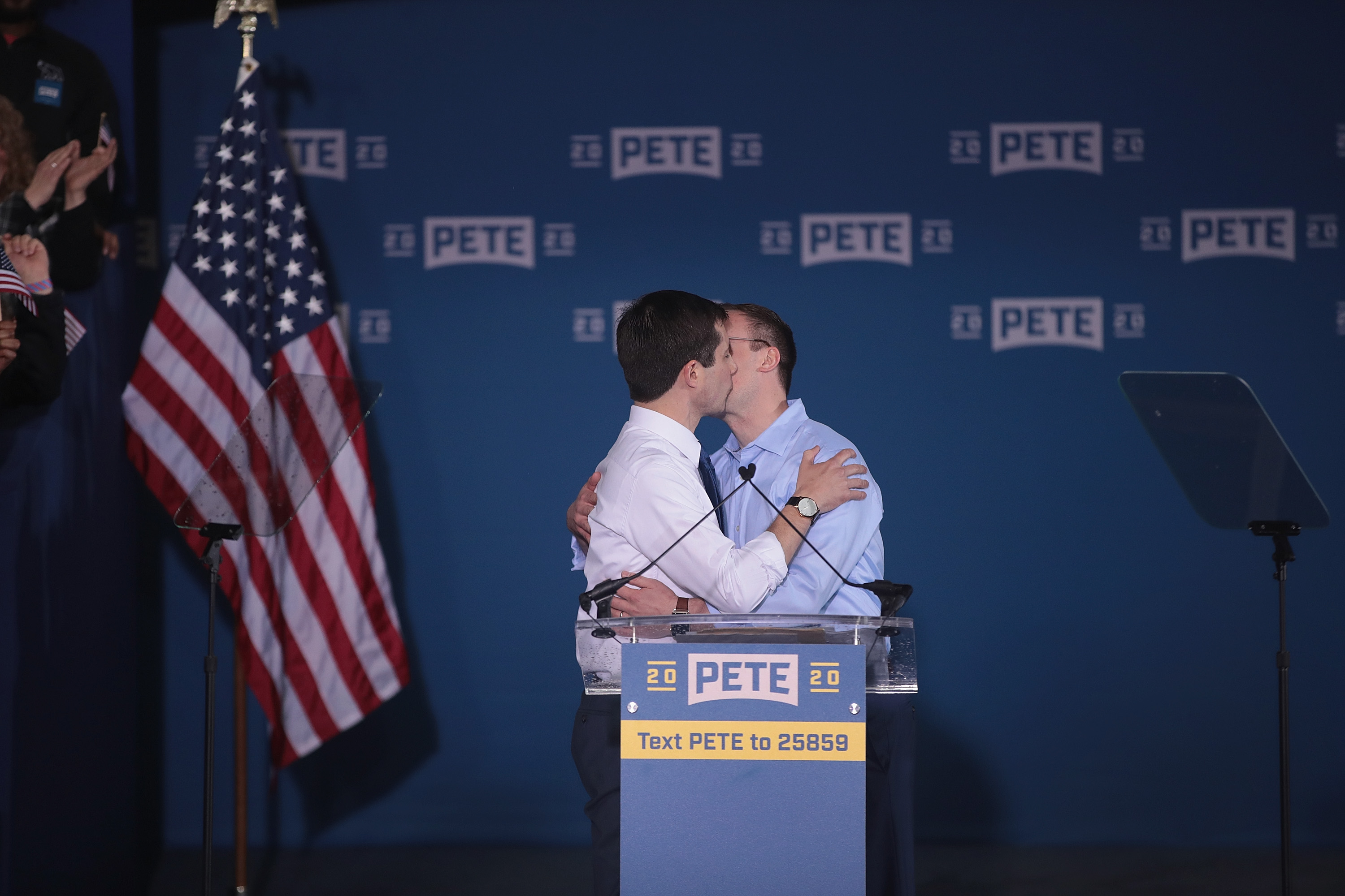 SOUTH BEND, INDIANA - APRIL 14: South Bend Mayor Pete Buttigieg kisses his husband Chasten Glezman announcing that he will be seeking the Democratic nomination for president during a rally in the old Studebaker car factory on April 14, 2019 in South Bend, Indiana. Buttigieg has been drumming up support for his run during several recent campaign swings through Iowa, where he will be retuning to continue his campaign later this week. (Photo by Scott Olson/Getty Images)