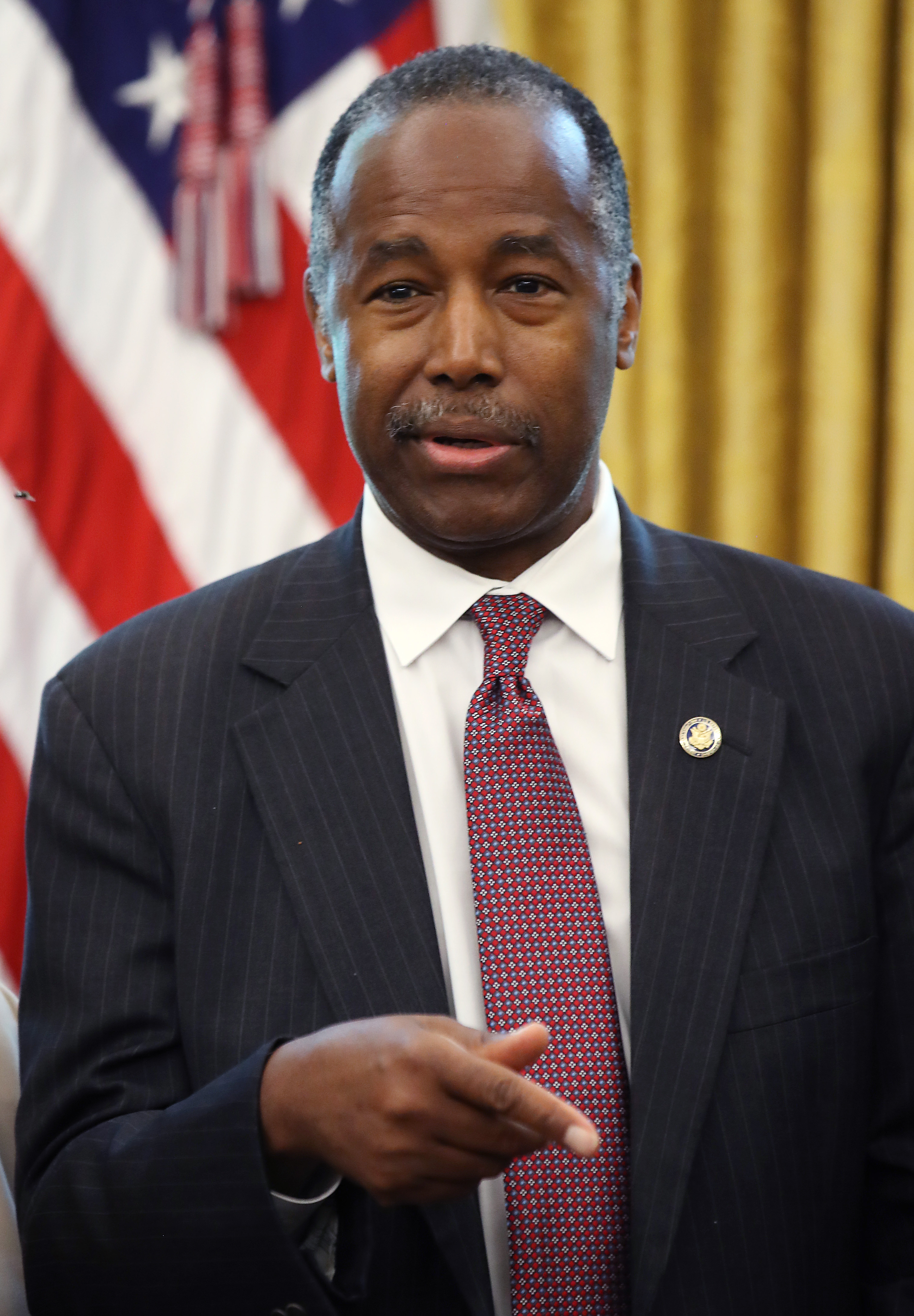 WASHINGTON, DC - JUNE 25: Housing and Urban Development Secretary Ben Carson speaks after U.S. President Donald Trump signed an executive order establishing a White House Council on eliminating regulatory barriers to affordable housing, in the Oval Office at the White House on June 25, 2019 in Washington, DC. The council, which will be made up of members of eight federal agencies, will reportedly be tasked with easing local barriers to the private sector of creating housing, according to published reports. (Photo by Mark Wilson/Getty Images)
