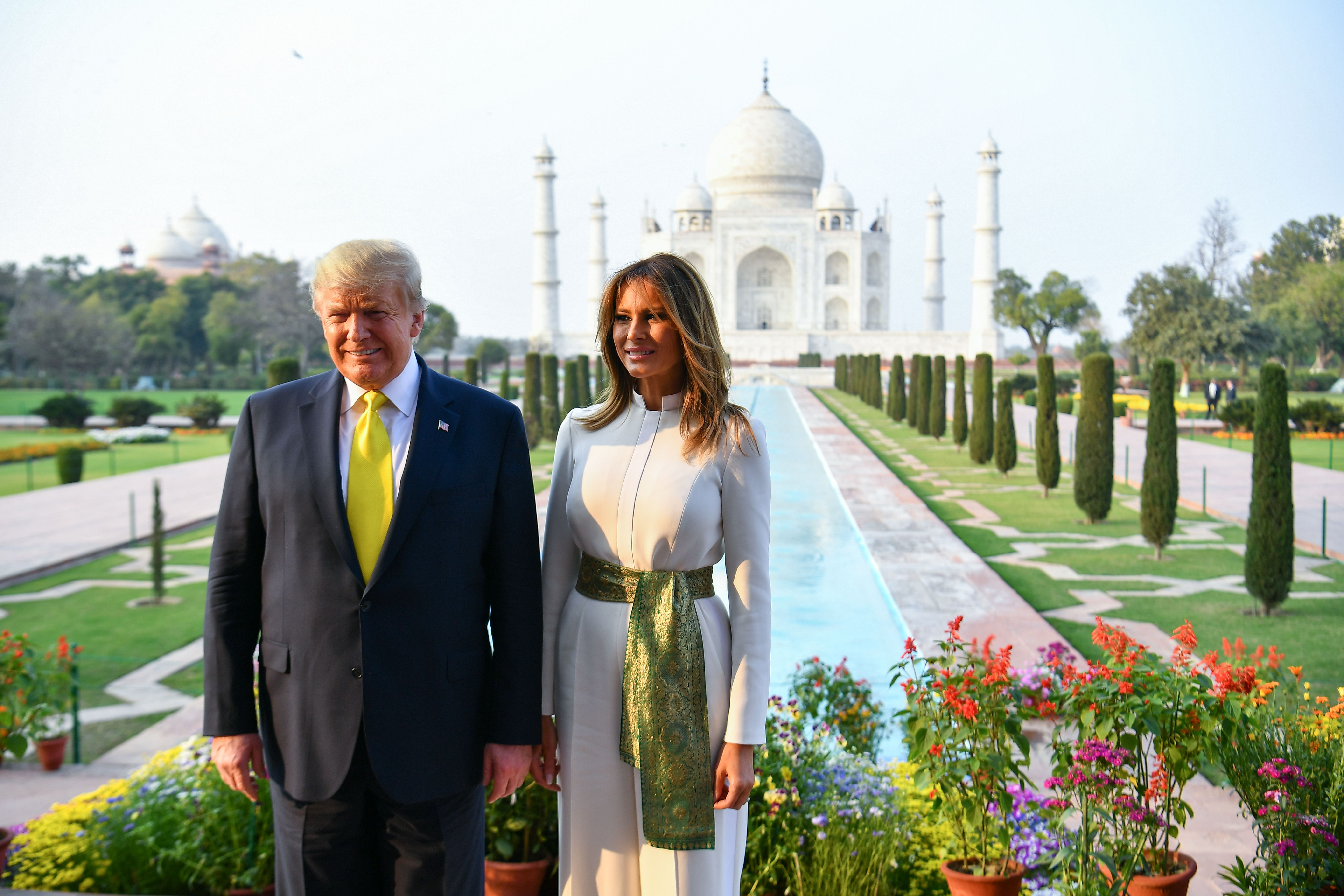 US President Donald Trump and First Lady Melania Trump pose as they visit the Taj Mahal in Agra on February 24, 2020. (MANDEL NGAN/AFP via Getty Images)