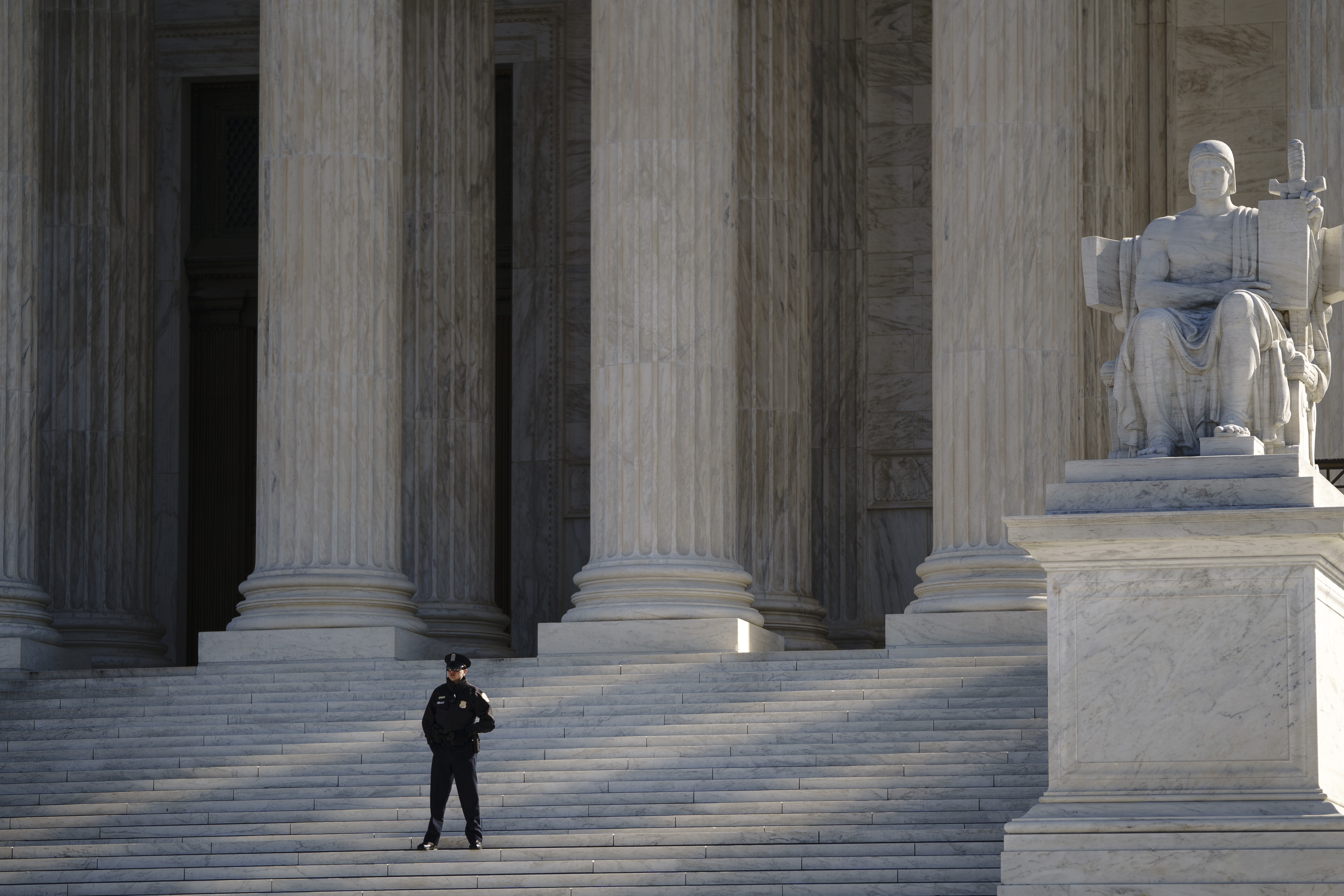 WASHINGTON, DC - MARCH 02: A Supreme Court Police officer stands watch on the steps outside the U.S. Supreme Court on March 2, 2020 in Washington, DC. On Monday, the U.S. Supreme Court is hearing a major case concerning the rights of some asylum seekers to challenge their expedited removal from the country. The Trump administration is asking the Supreme Court to reverse an opinion of the 9th Circuit Court of Appeals that would allow some individuals who have been denied asylum the opportunity to make a claim in federal court. (Photo by Drew Angerer/Getty Images)